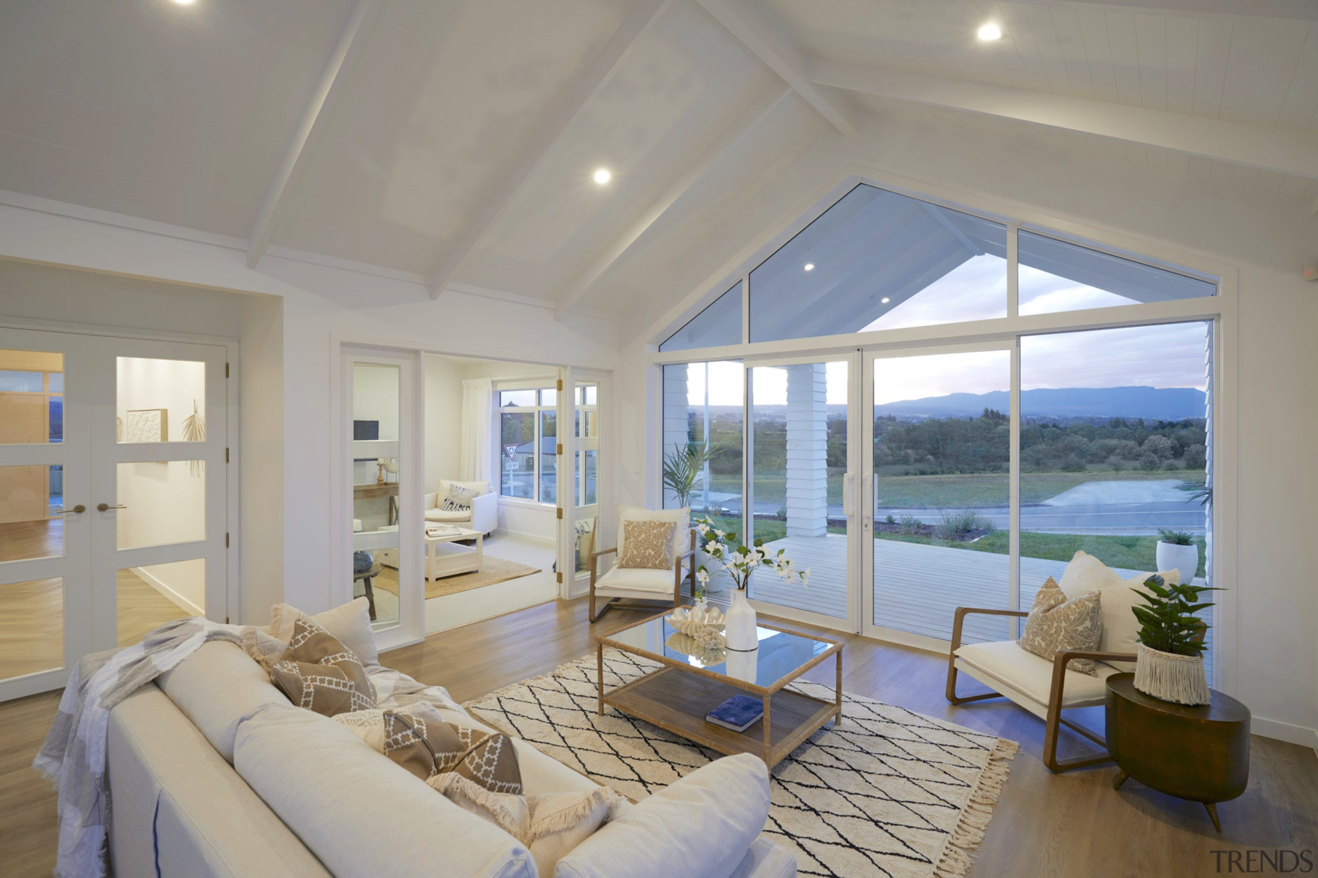 The gabled roofline translates into a soaring ceiling