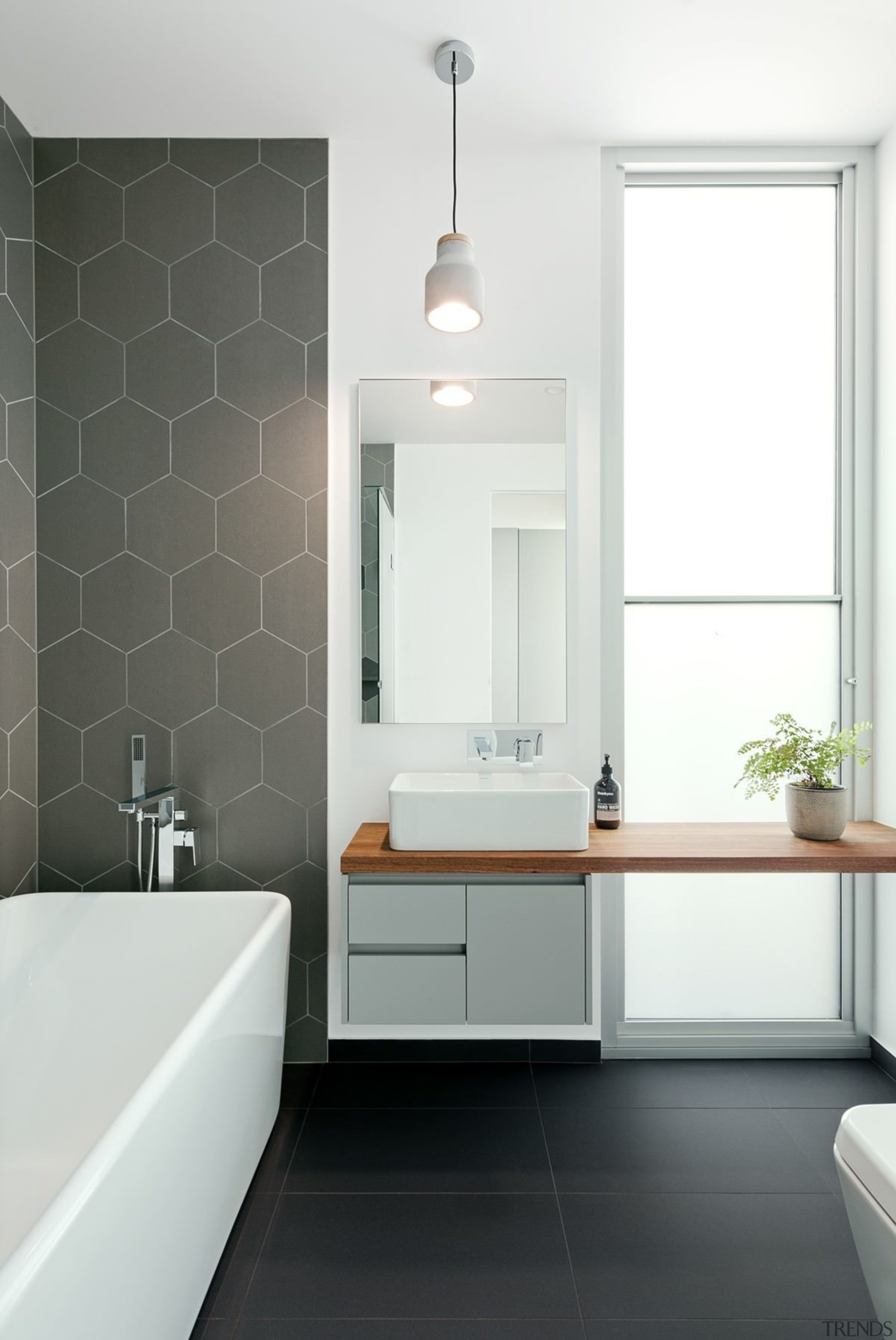 Trends] | Dark tiles contrast with the white walls and ceiling
