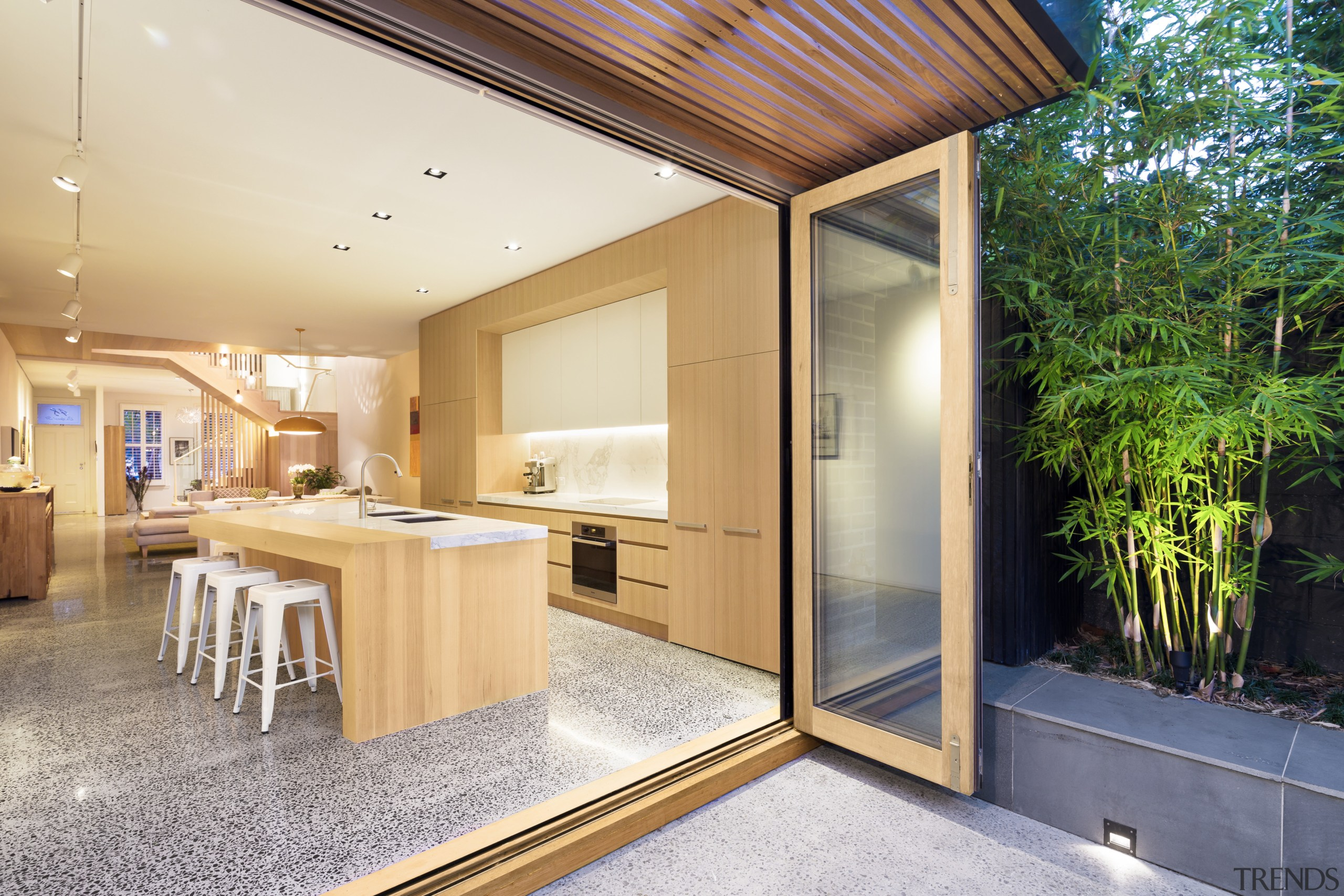 Understated, yet packed with hidden functionality, this kitchen architecture, home, house, interior design, real estate, orange, white