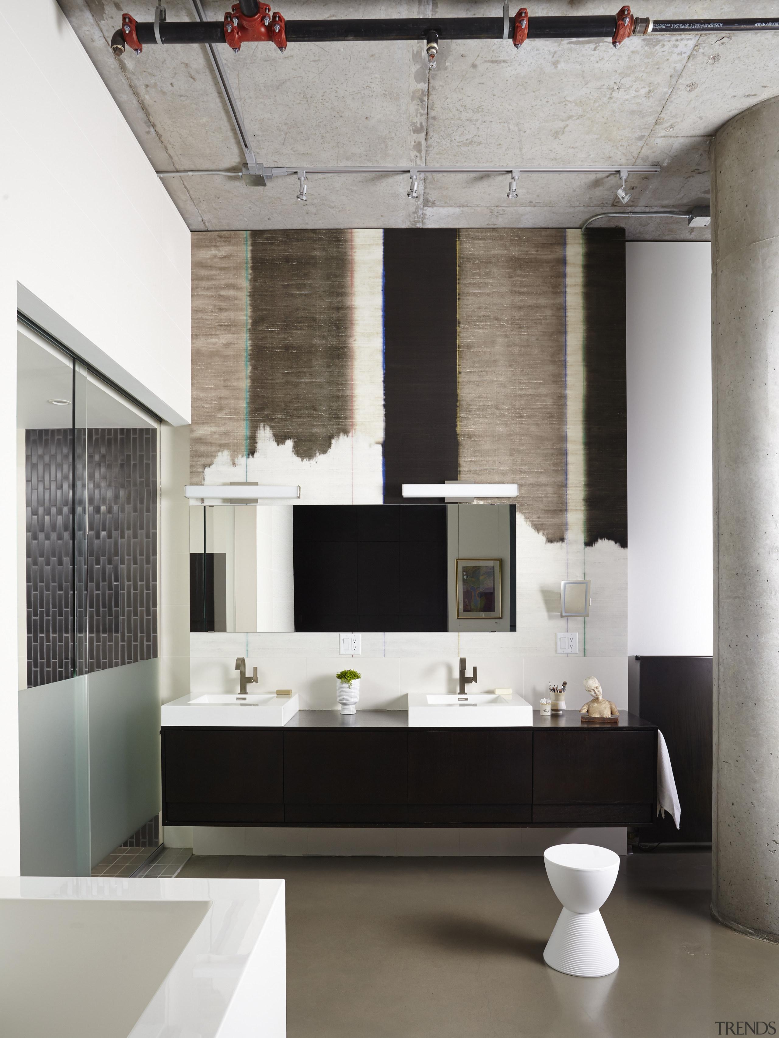 Designer distressed wallpaper hung behind the vanity brings floor, flooring, furniture, interior design, living room, wall, gray