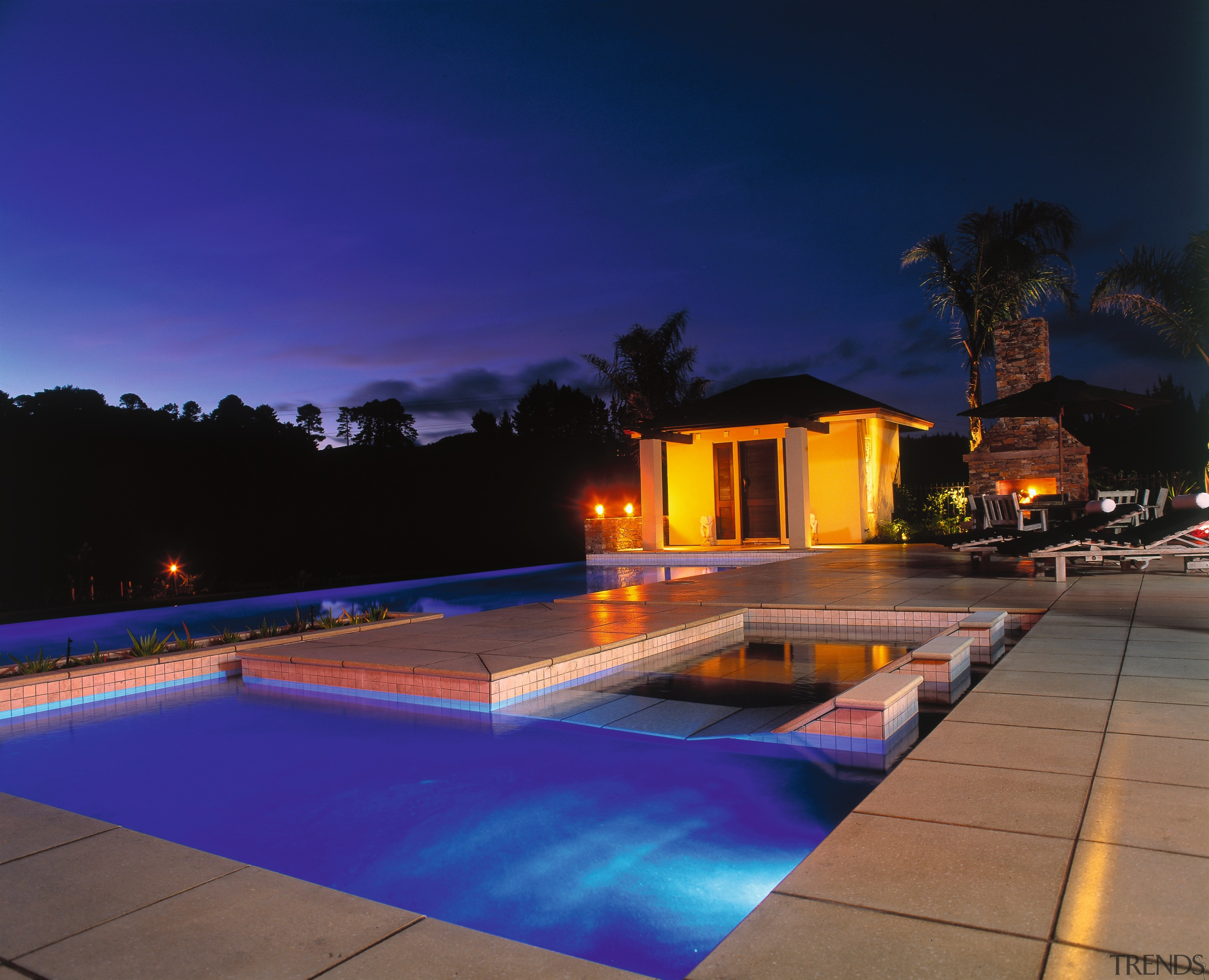 Evening shot of outdoor pool with large paving architecture, estate, home, house, leisure, lighting, property, real estate, reflection, resort, sky, swimming pool, water, blue