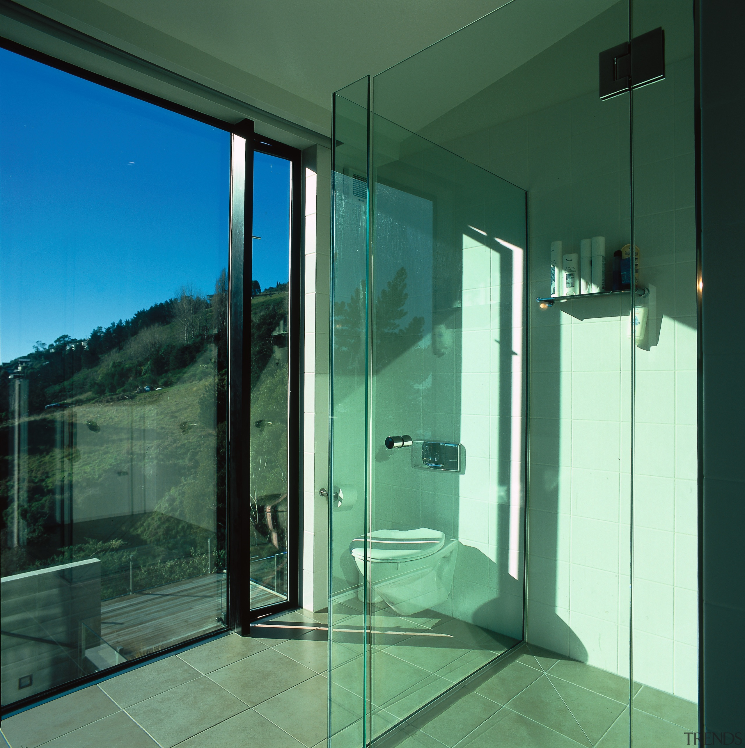View of the bathroom, floor-to-ceiling windows and a architecture, daylighting, door, glass, house, window, green, teal