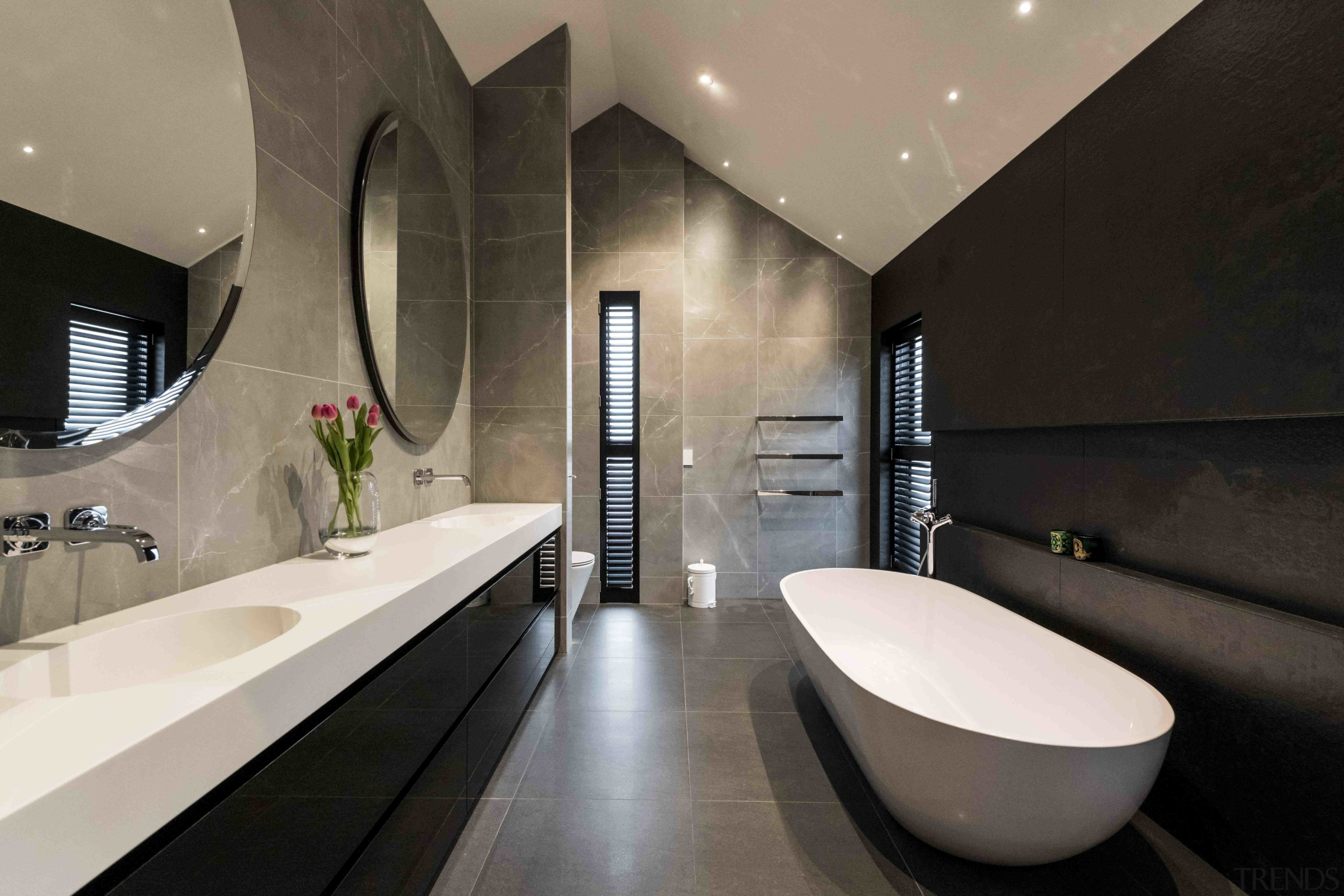 Dramatically high-pitched ceiling and comparatively low ceilings all architecture, bathroom, bathtub, building, ceiling, floor, home, house, interior design, plumbing fixture, property, real estate, room, tap, tile, gray, black