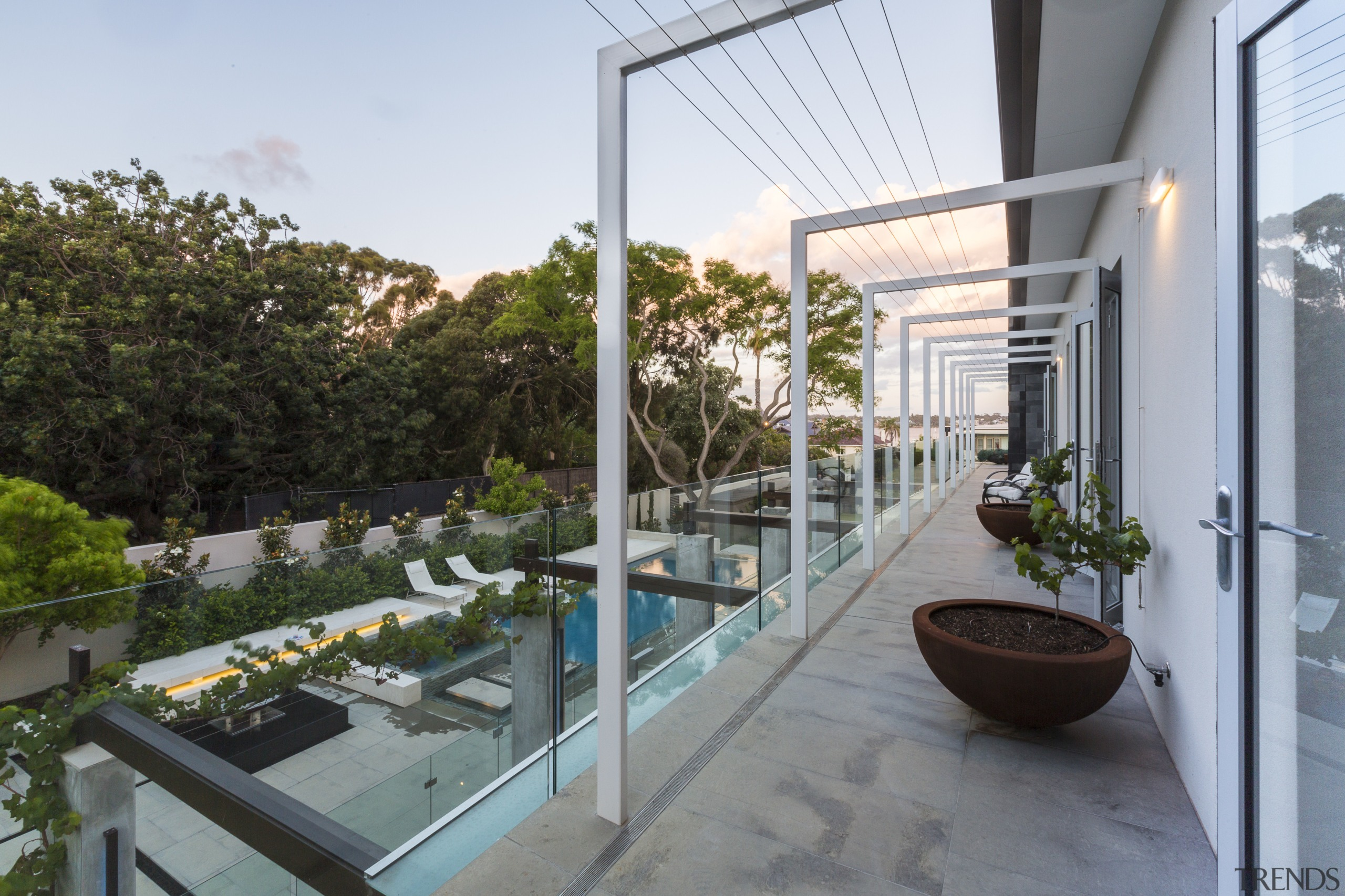 French doors in the bedrooms in this renovated apartment, balcony, condominium, courtyard, outdoor structure, plant, property, real estate, roof, white, gray