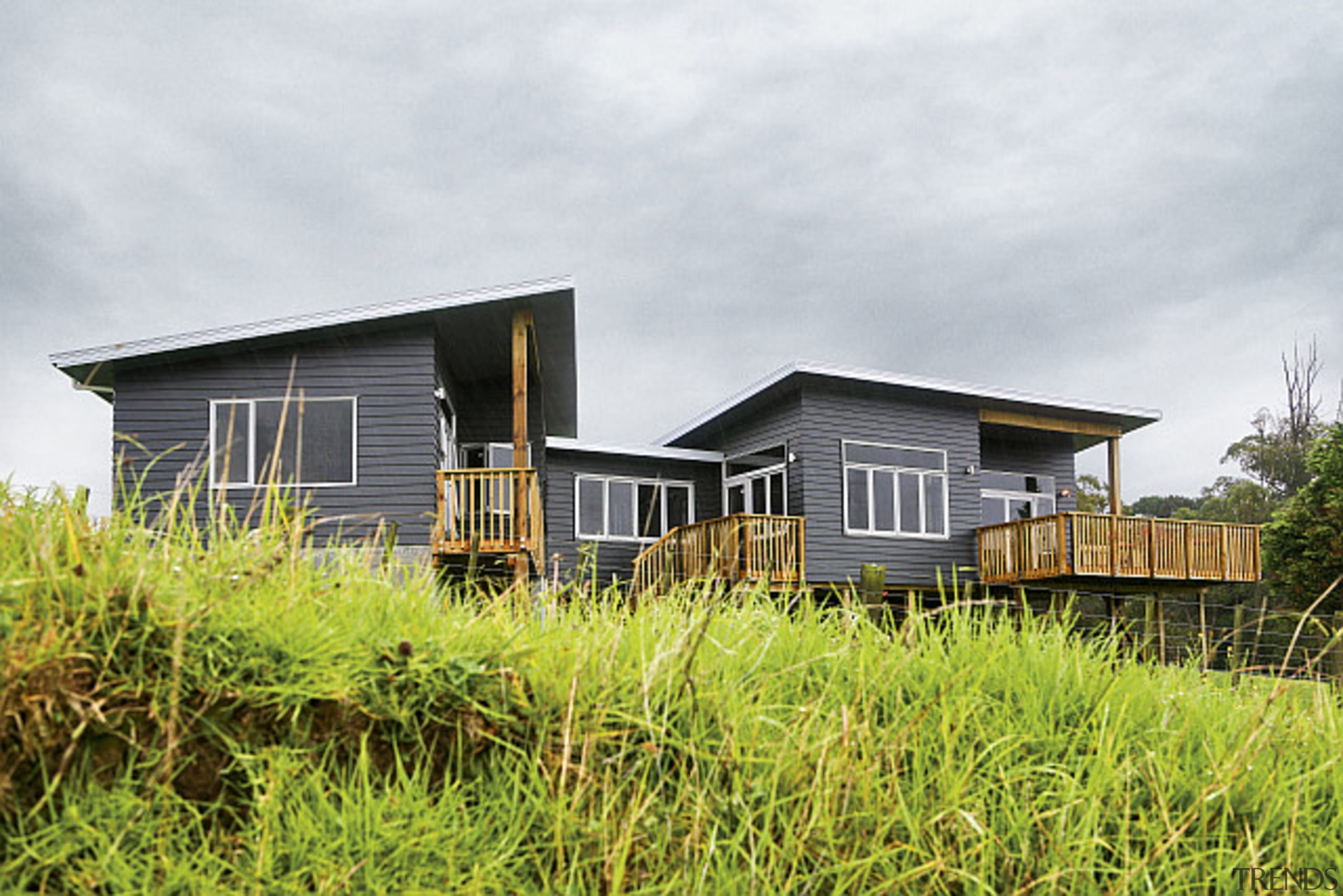 This Linea weatherboard home was built in Taranaki cottage, farmhouse, grass, home, house, land lot, property, real estate, white