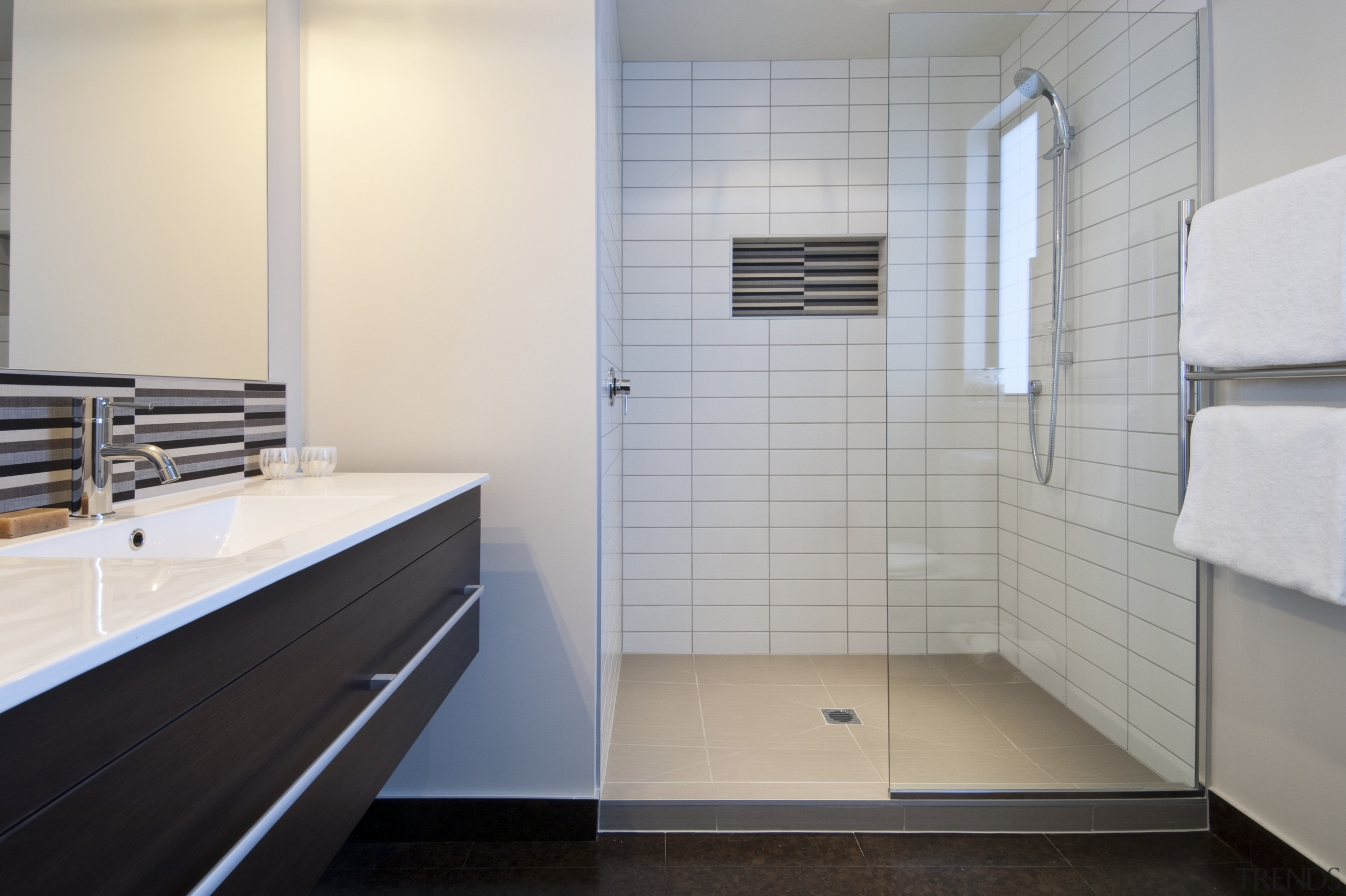 This Upper Hutt Show home was designed and architecture, bathroom, floor, flooring, interior design, plumbing fixture, room, sink, tile, gray
