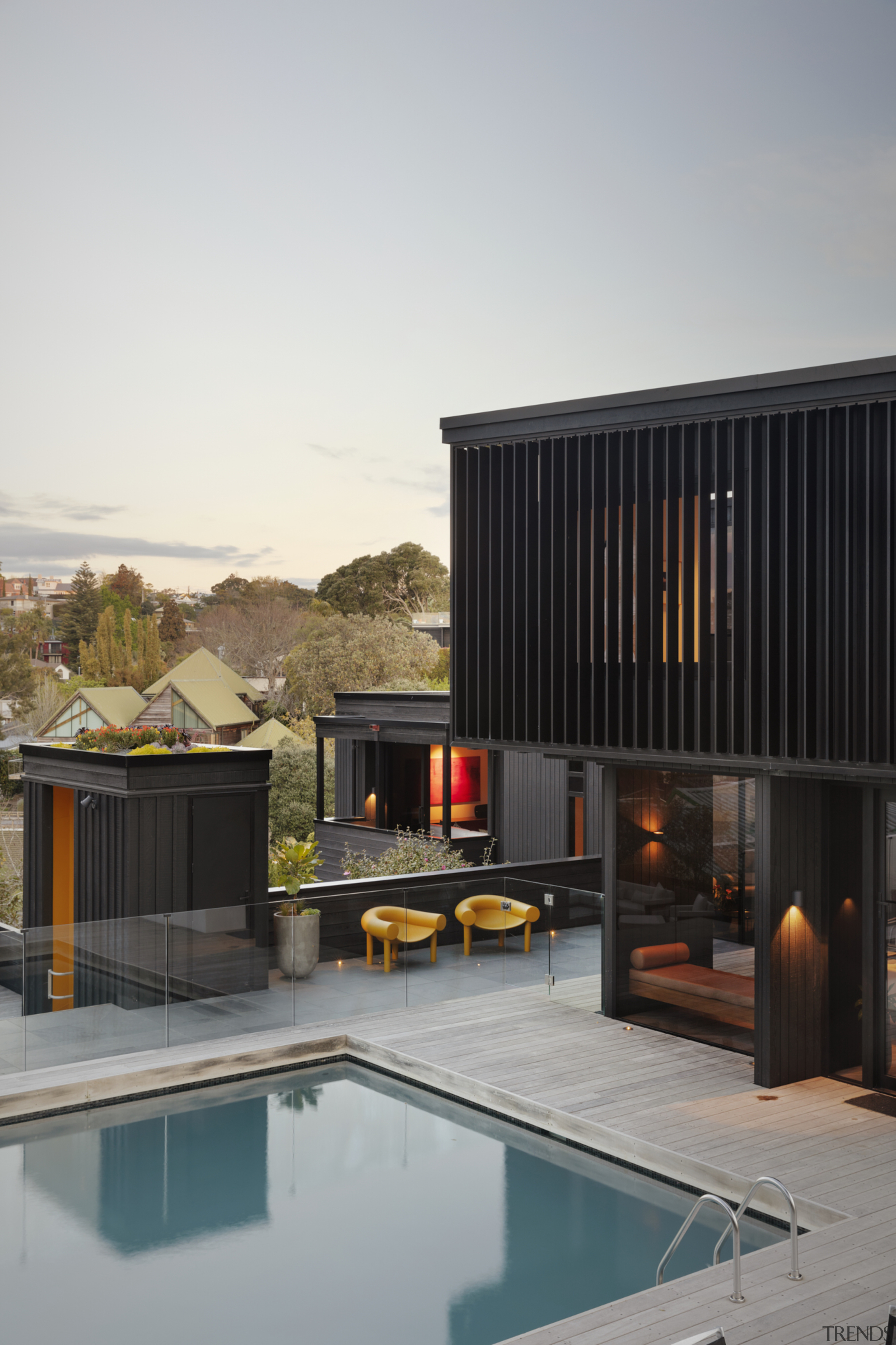 1970's home becomes a modern entertainer's dream - architecture, backyard, building, courtyard, design, estate, facade, furniture, home, house, interior design, property, real estate, residential area, roof, room, sky, swimming pool, gray, black