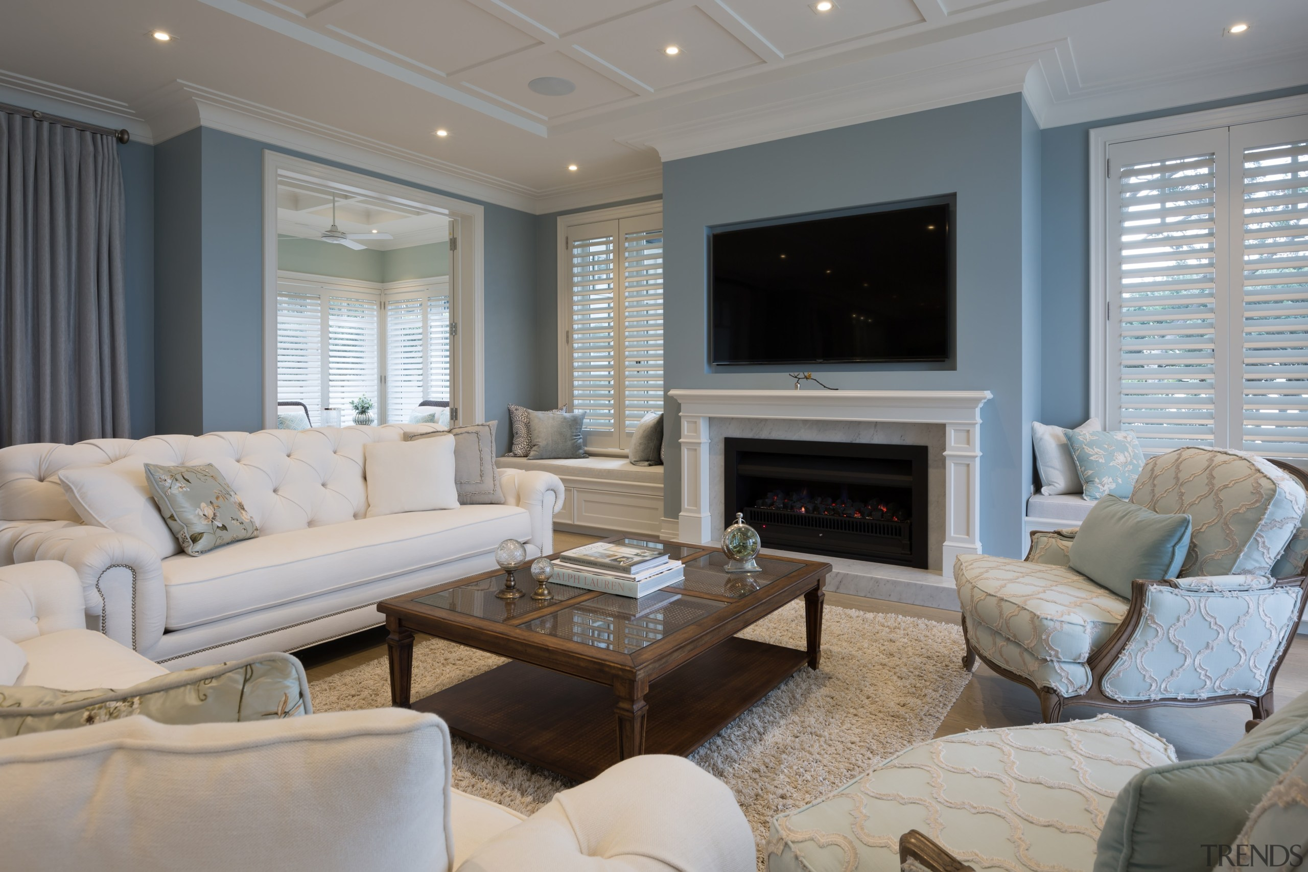 The television set is recessed above the fireplace home, interior design, living room, real estate, room, window, gray