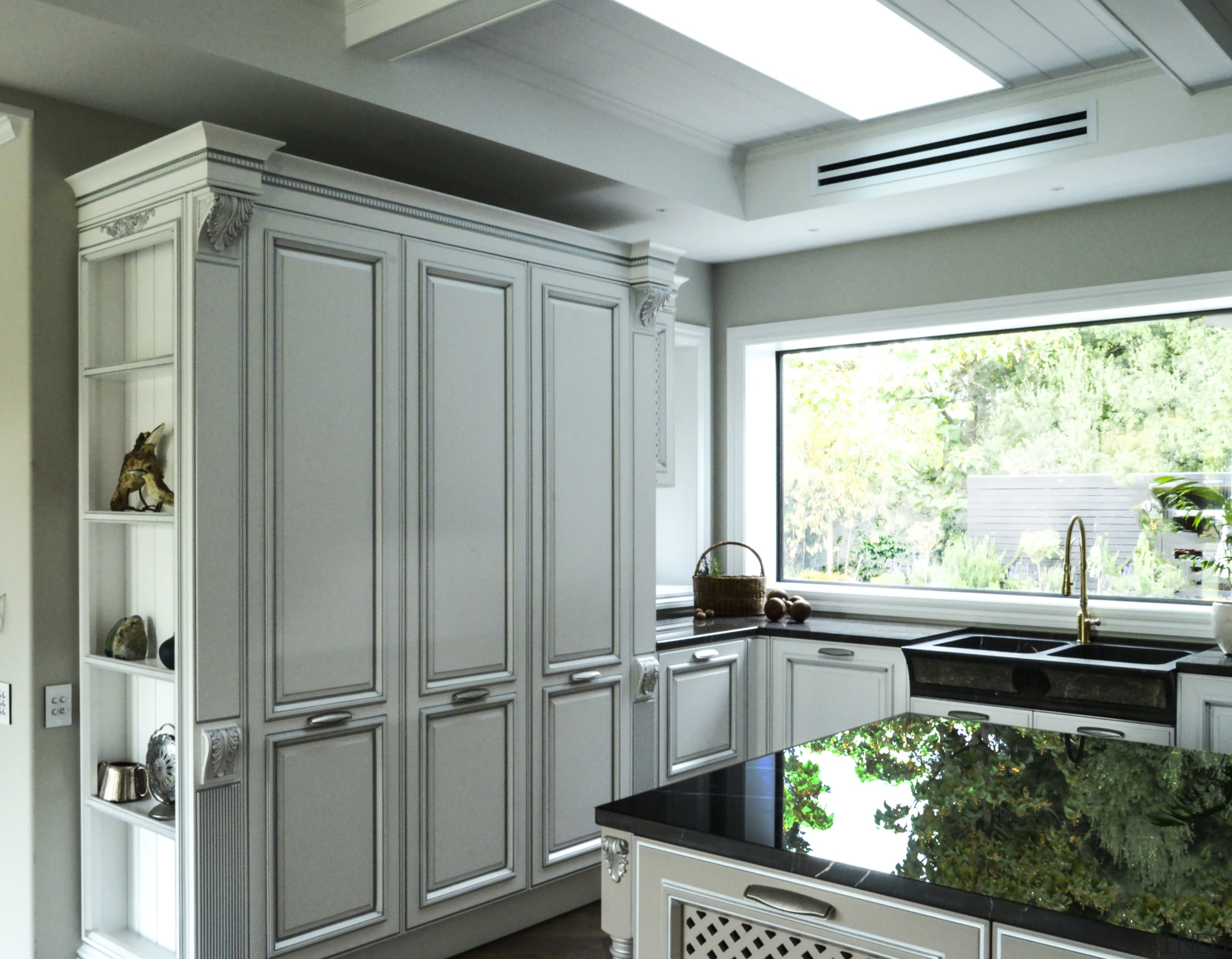 While this large kitchen\'s panelled cabinet style ...   Trends