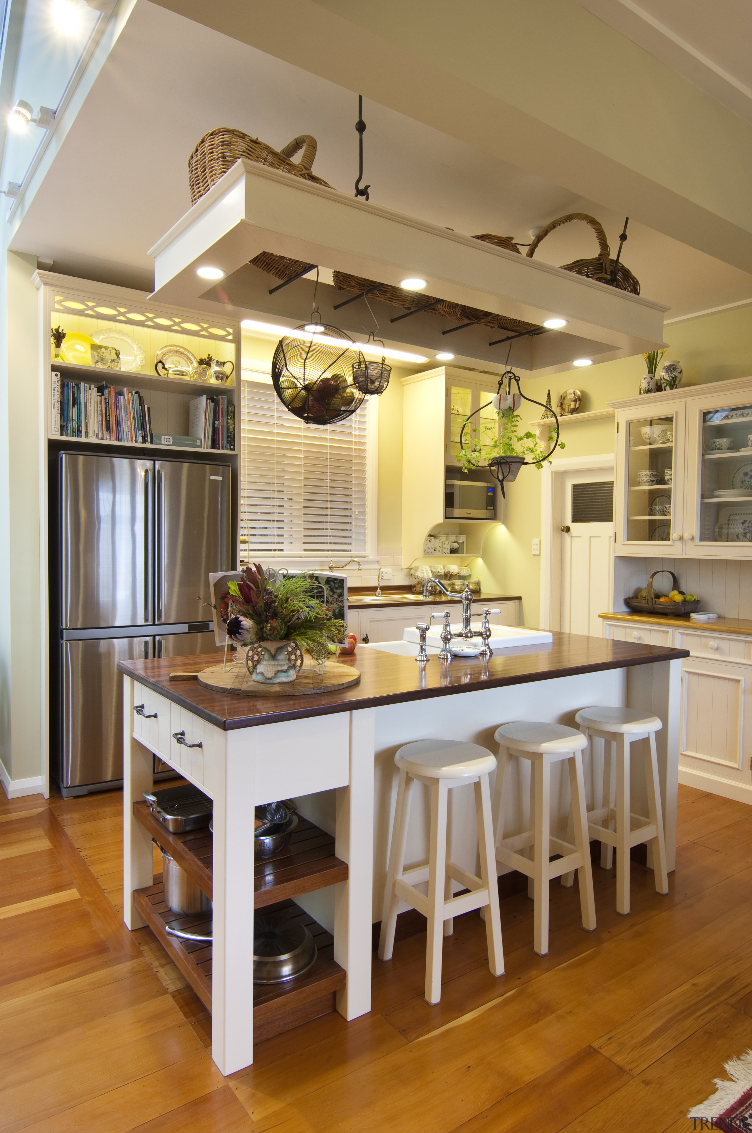 central white furniture-style island with wooden top cabinetry, ceiling, countertop, cuisine classique, dining room, furniture, interior design, kitchen, room, table, brown