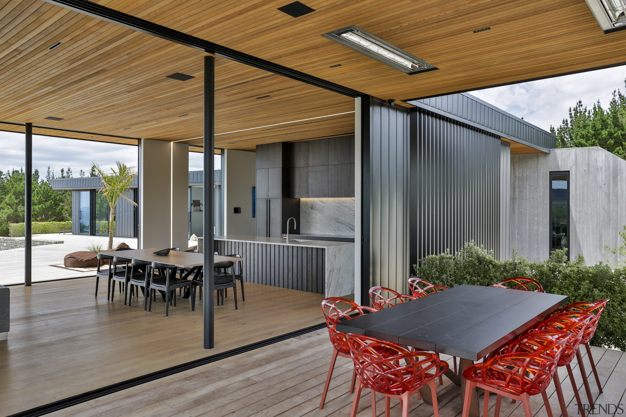 This home's vertical shiplap cladding finds an echo