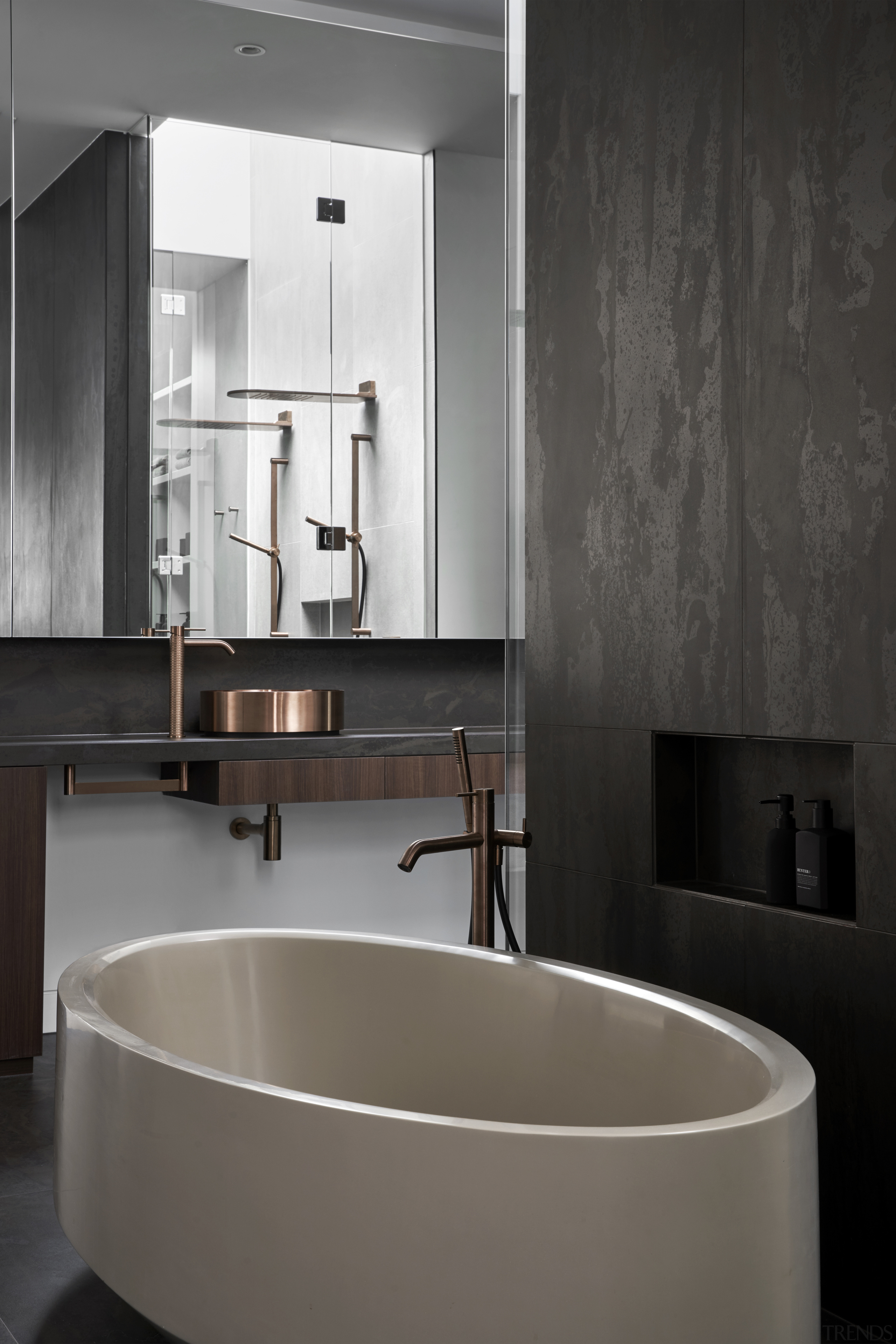 Copper fittings in the main bathroom are echoed