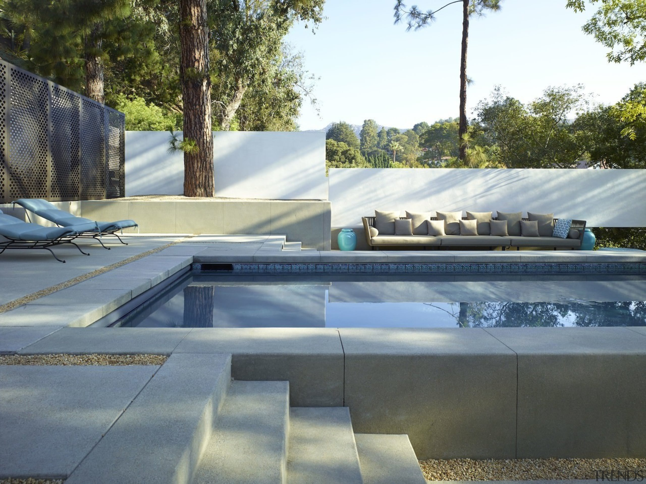 The pool area is spacious and features a architecture, automotive exterior, daylighting, house, outdoor structure, property, roof, swimming pool, water, gray