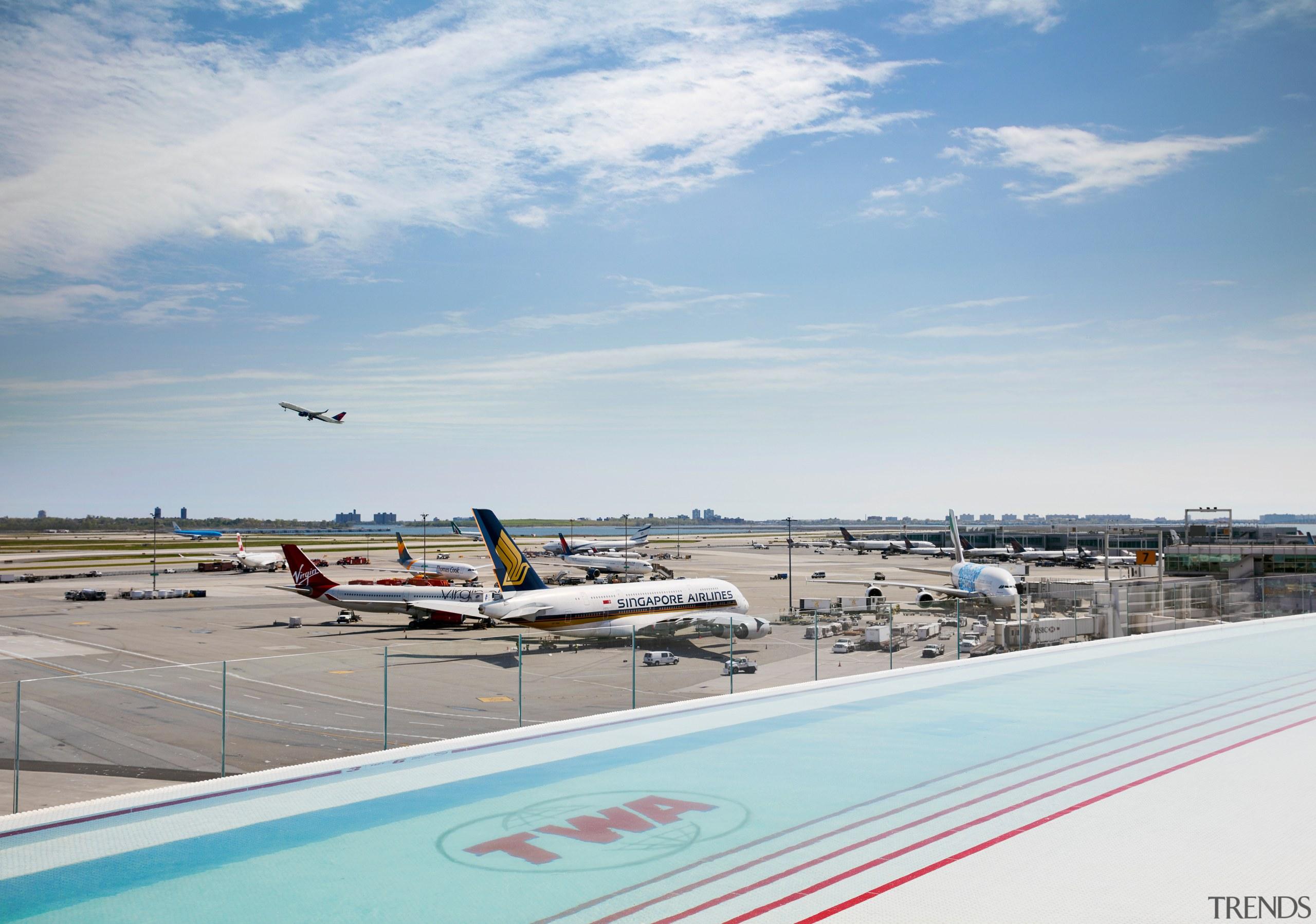 The TWA Hotel's rooftop infinity pool and observation TWA Hotel rooftop pool,  observation deck, JFK runway 4