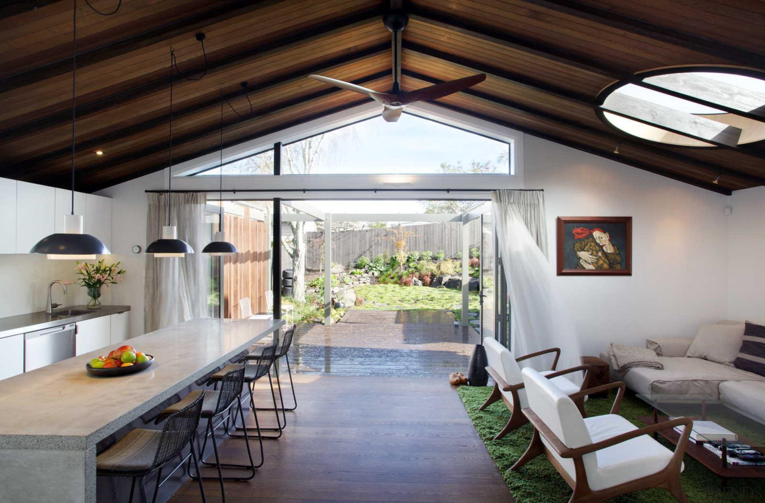 The villa's deck offers an additional exterior living ceiling, daylighting, house, interior design, real estate, roof, window, gray, black