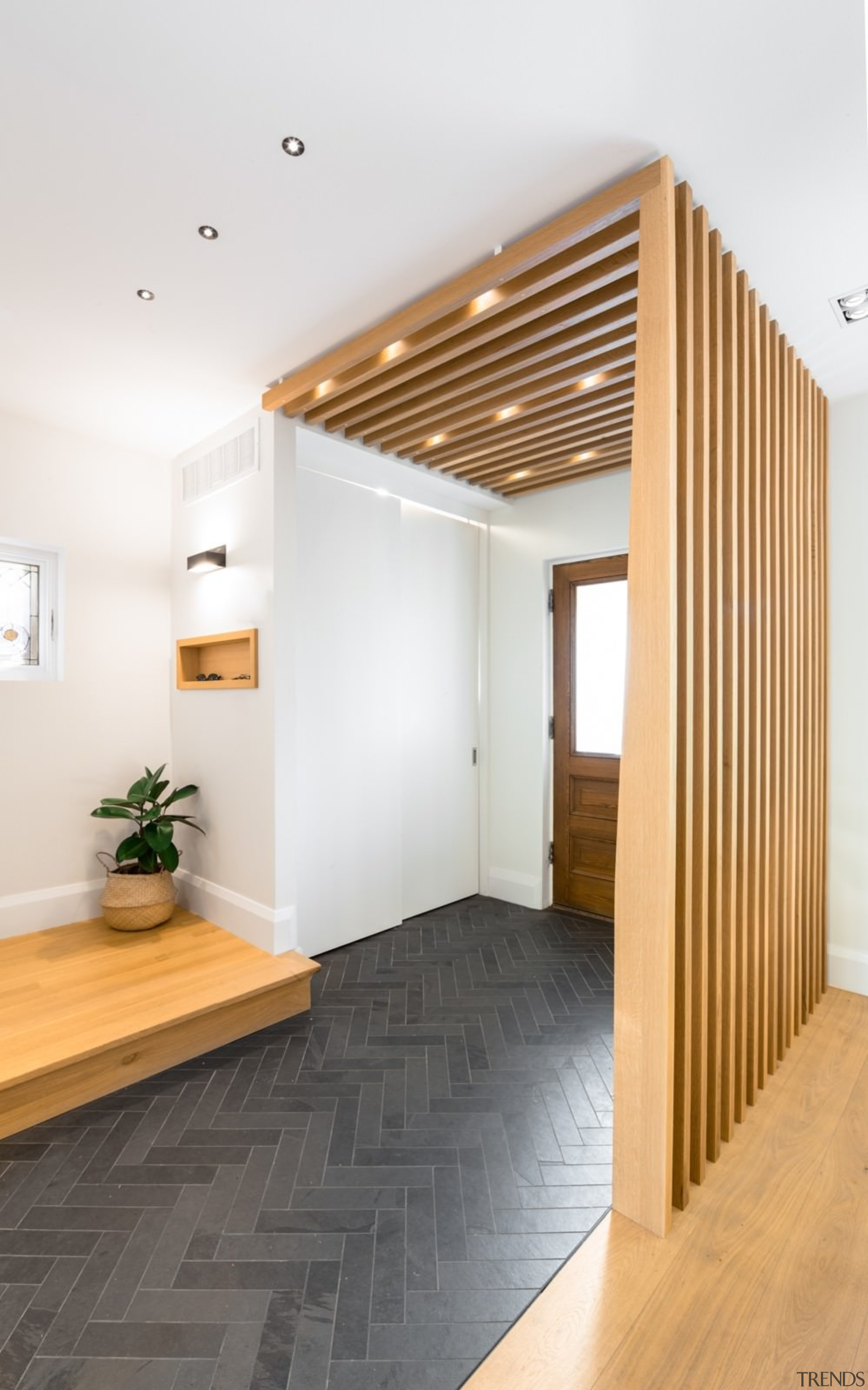 Slats run up from the herringbone floor and architecture, ceiling, floor, flooring, house, interior design, laminate flooring, product design, real estate, stairs, wood, wood flooring, white