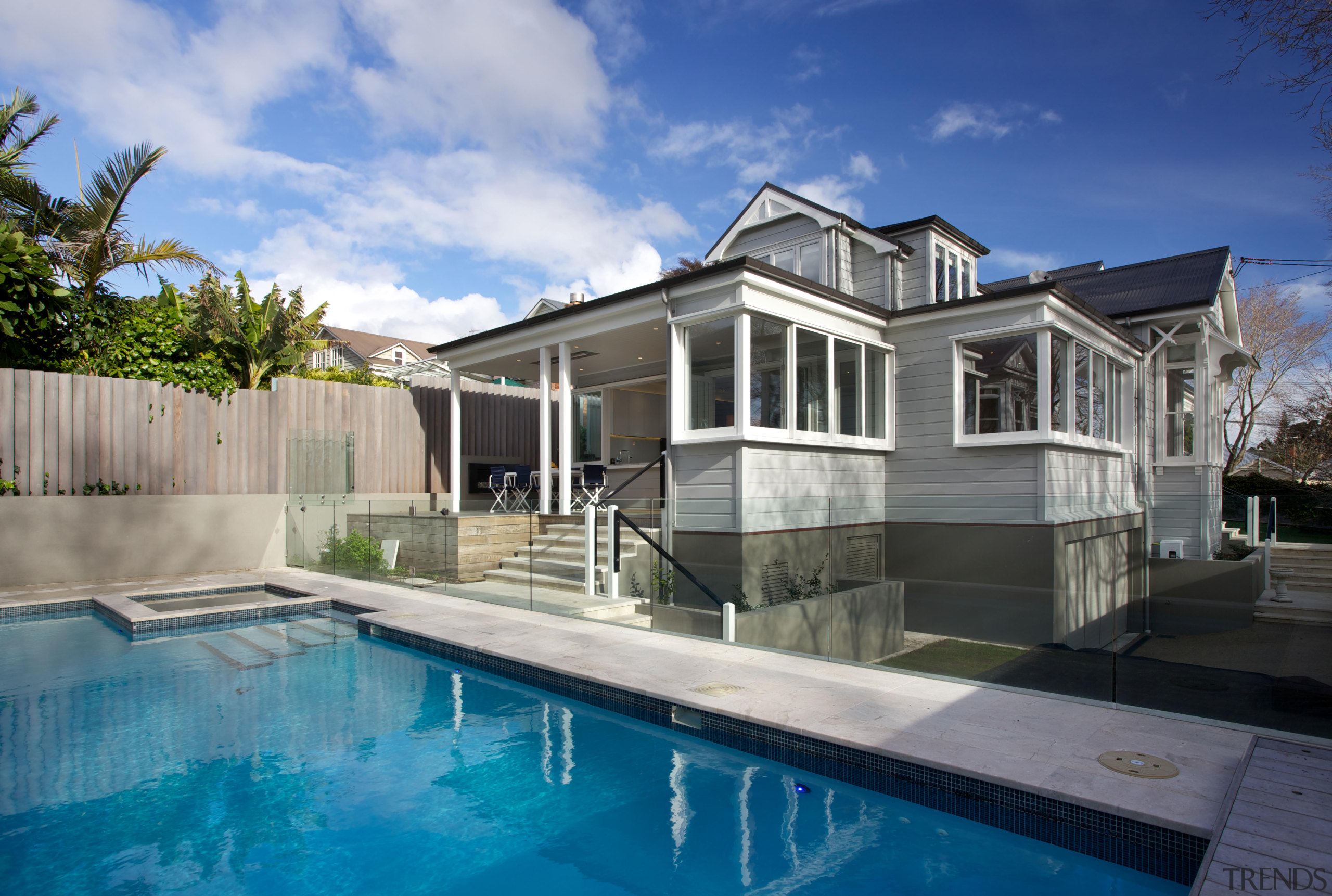 A major renovation by Scarlet Architects has transformed architecture, backyard, cottage, estate, facade, home, house, property, real estate, residential area, swimming pool, villa, teal, gray