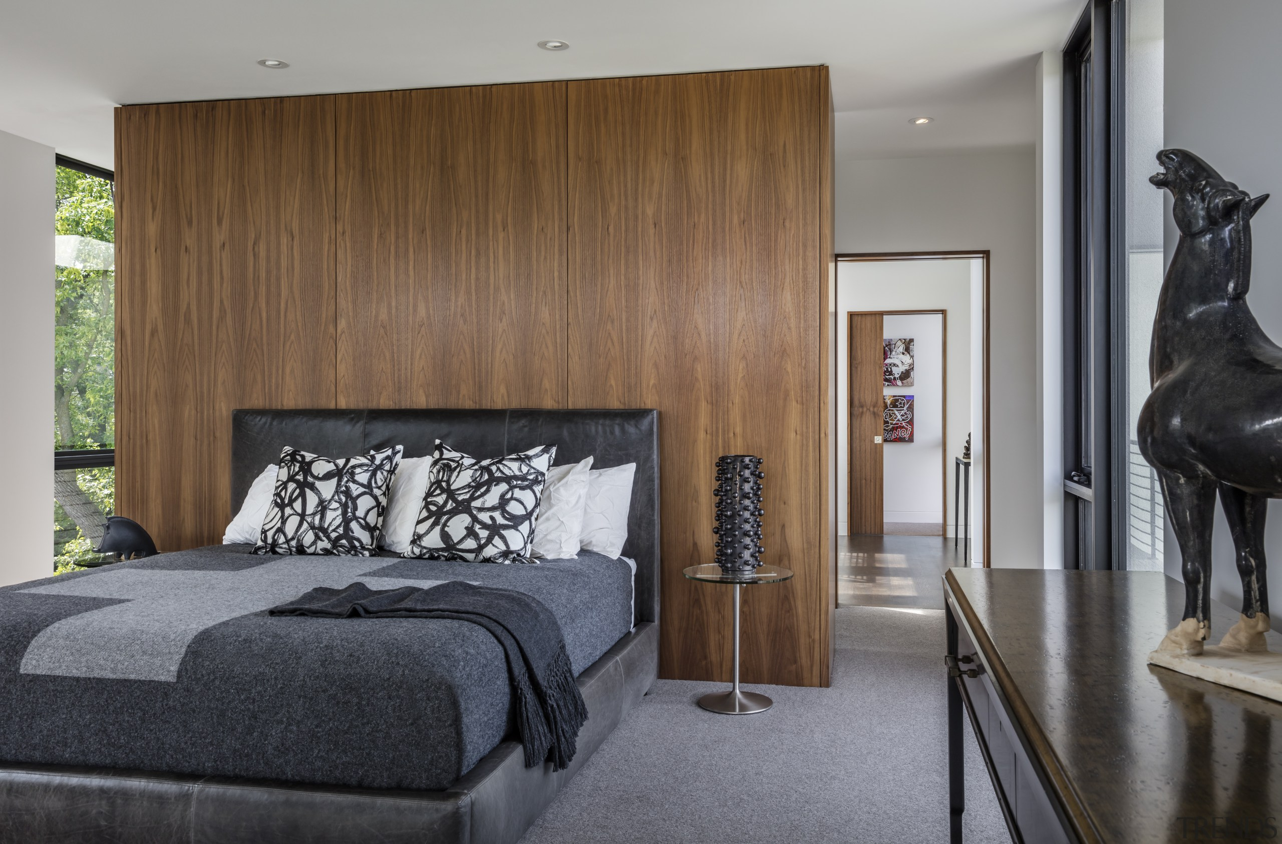 A partial wall clad in walnut anchors the bed, bedroom, furniture, home, interior design, room, wall, wood, Peterssen Keller Architects