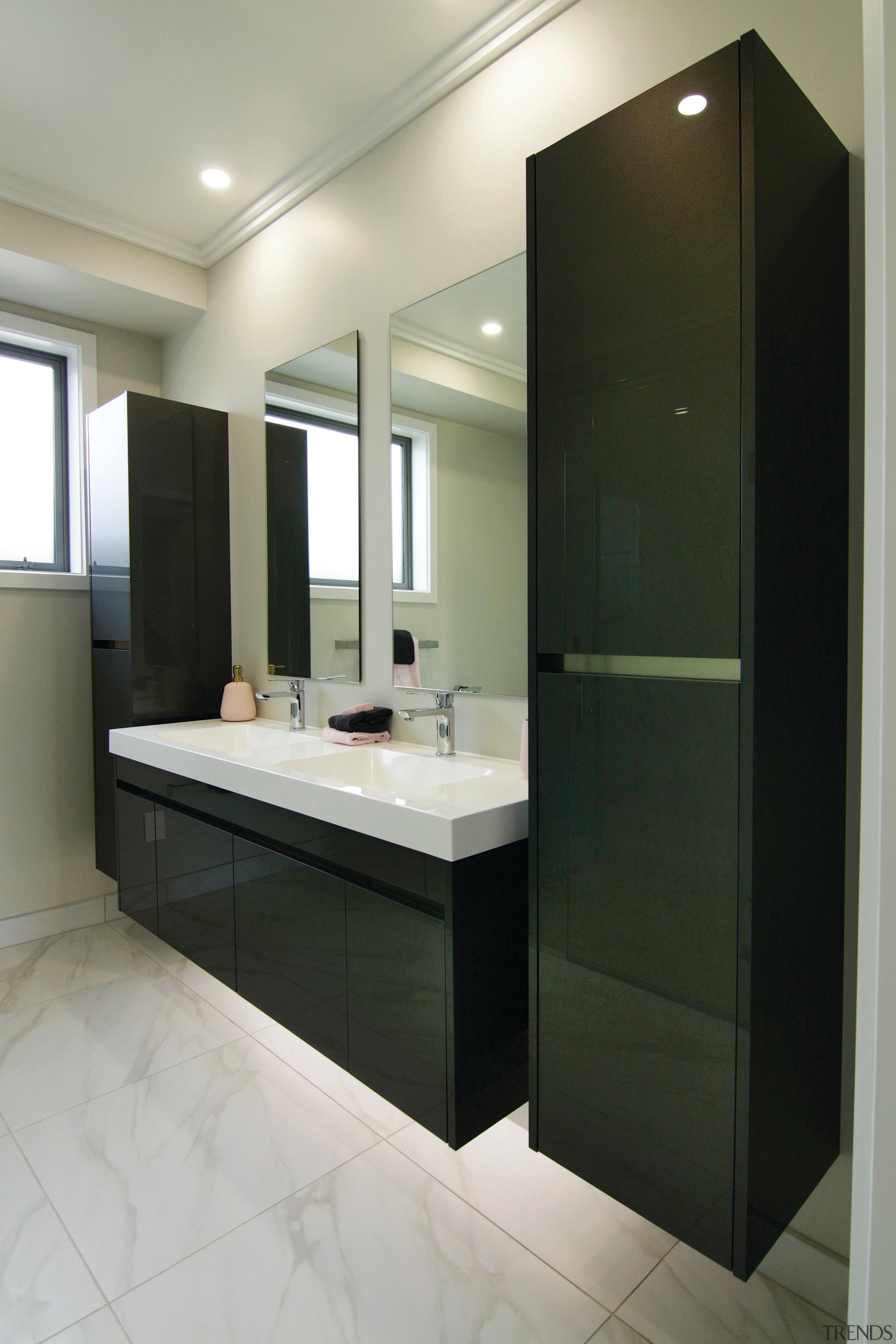 Crisp and contemporary, this bathroom forms part of bathroom, bathroom accessory, room, black, gray