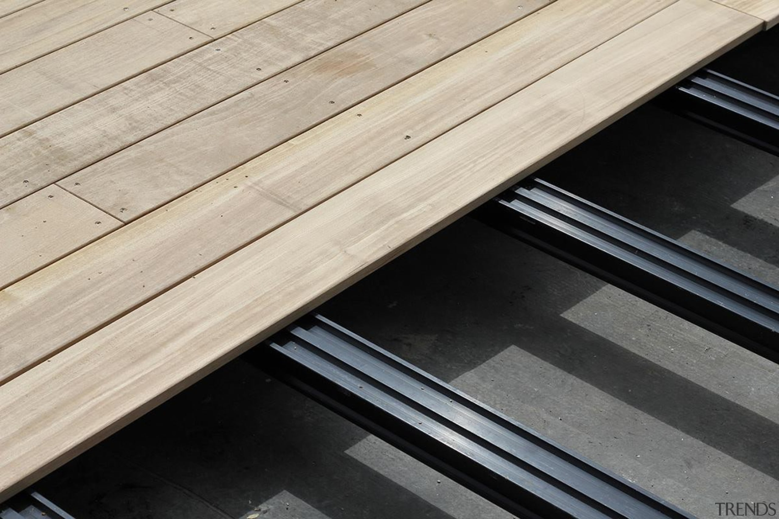 QWICKBUILD is the award-winning aluminium sub-frame system by angle, daylighting, floor, furniture, line, roof, steel, table, wood, wood stain, gray, black