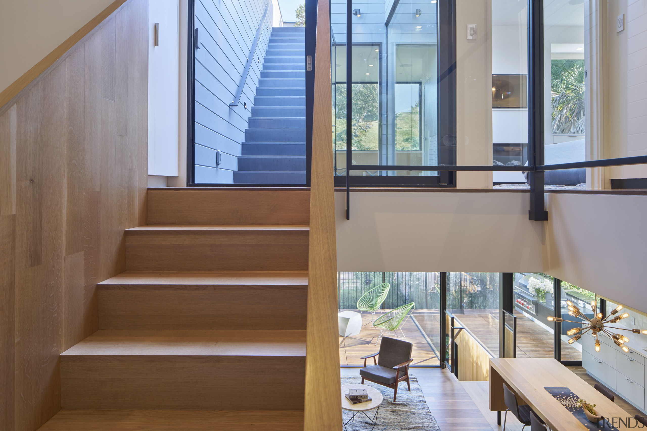 This kitchen connects to two outdoor living spaces architecture, daylighting, handrail, house, interior design, real estate, stairs, gray, brown