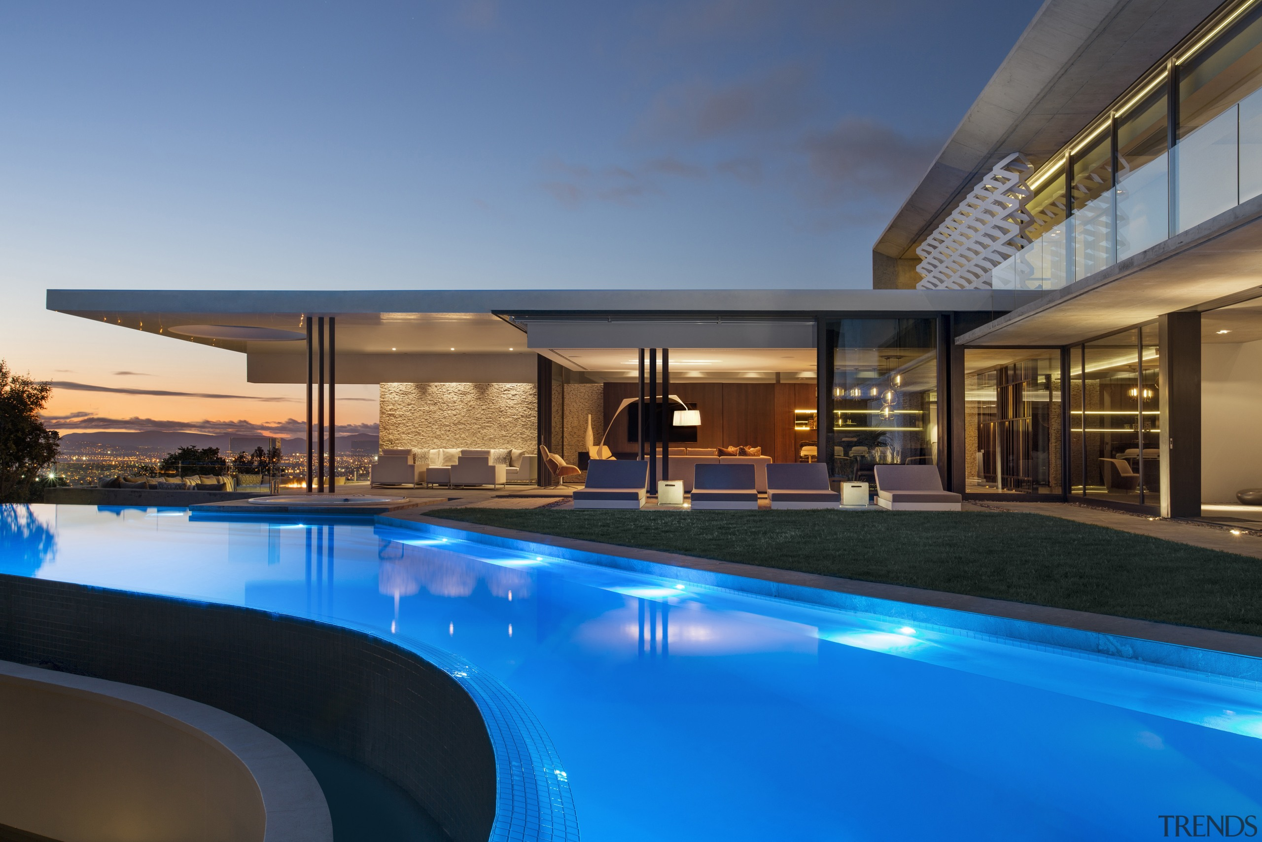 Set on the crest of a hill, this apartment, architecture, condominium, estate, home, hotel, house, leisure, lighting, property, real estate, reflection, resort, resort town, swimming pool, villa, blue