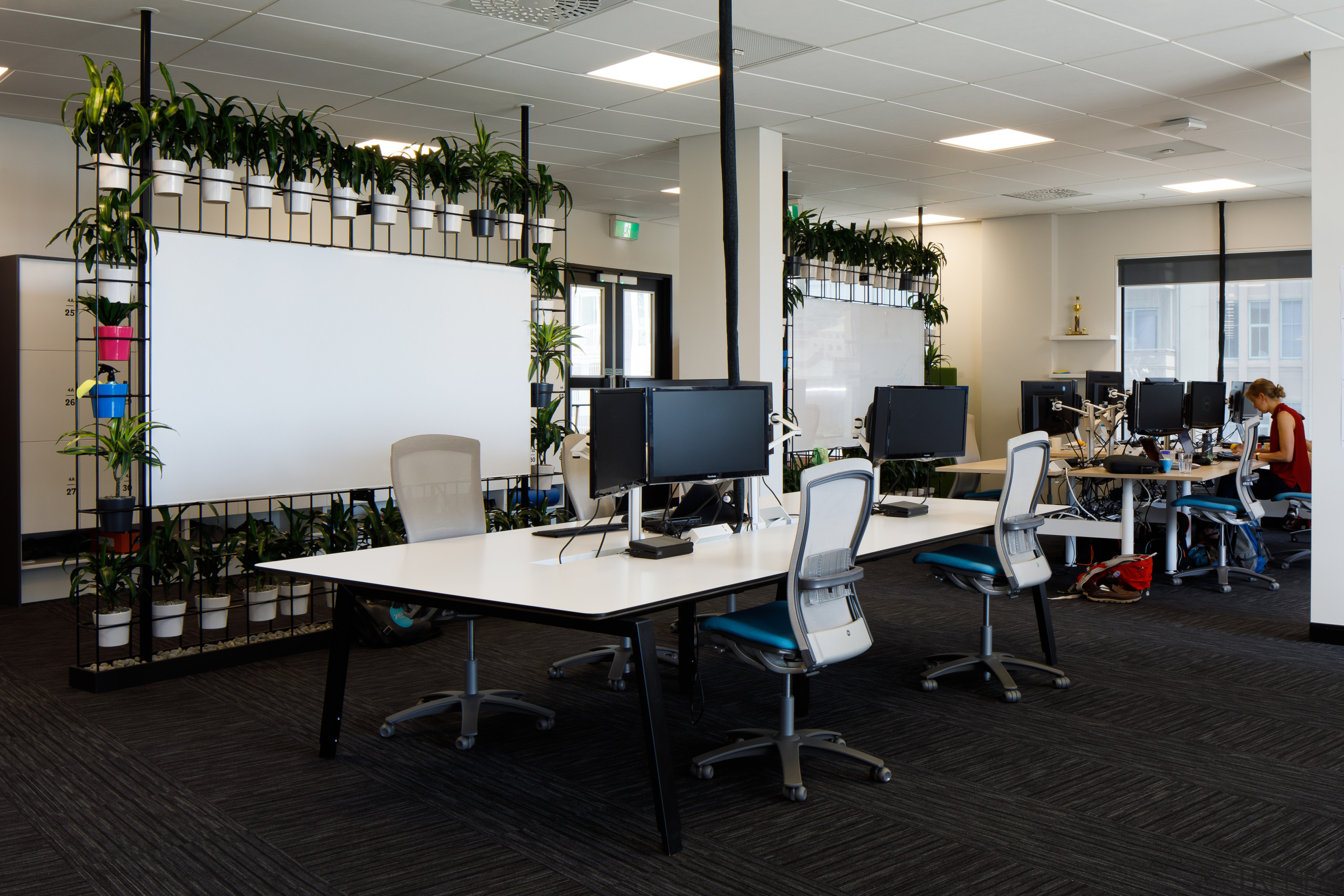 The reinvented and extended heritage building now contains architecture, building, design, desk, furniture, interior design, office, office chair, room, table, black, gray