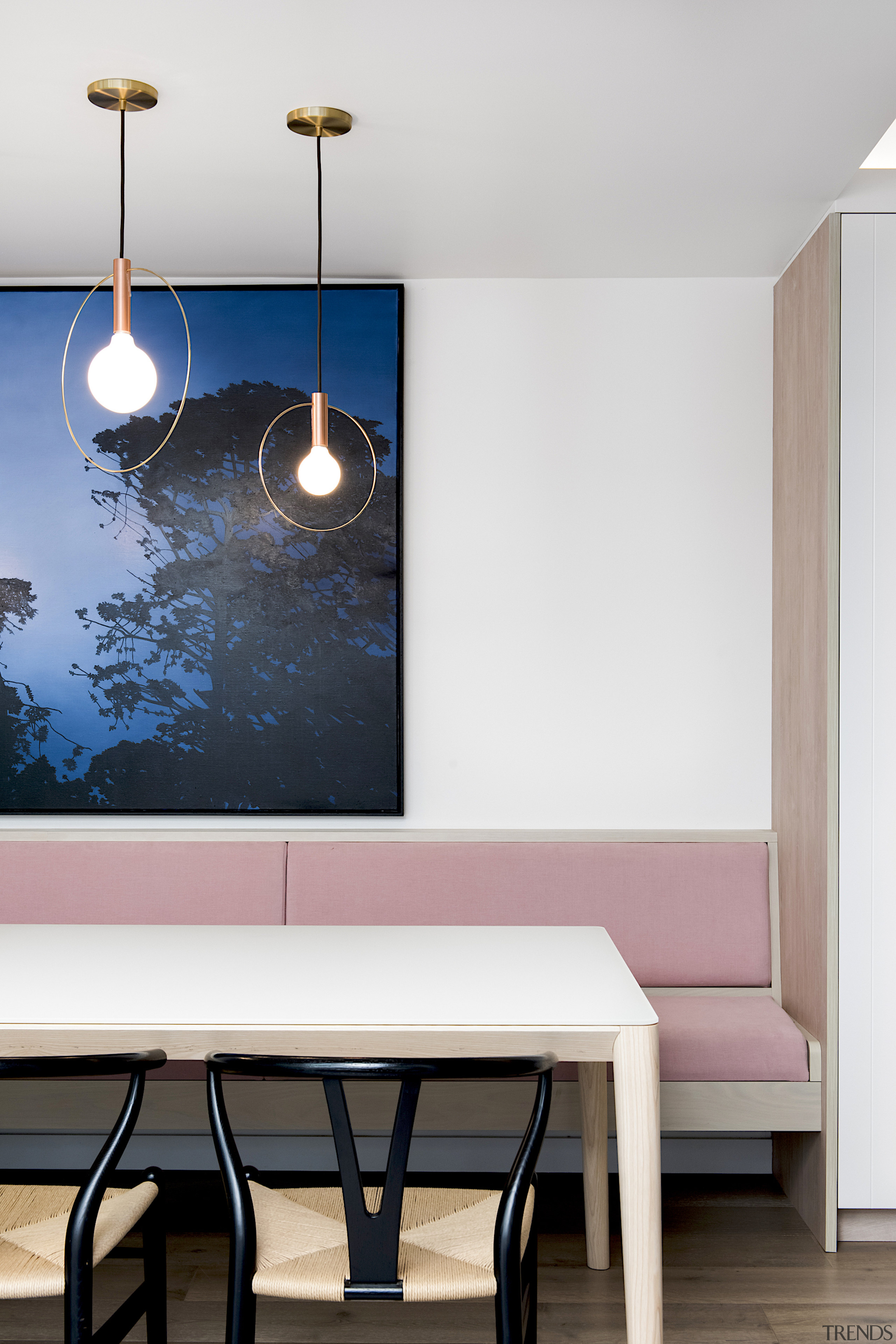 The kitchen's eye-catching pendants were designed by Minosa white