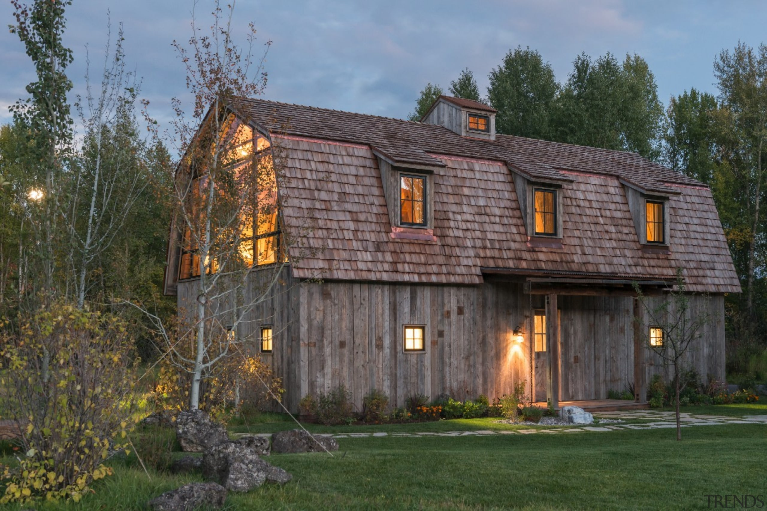 The contemporary additions manage to blend seamlessly with barn, building, cottage, estate, facade, farmhouse, home, house, log cabin, property, real estate, shed, siding