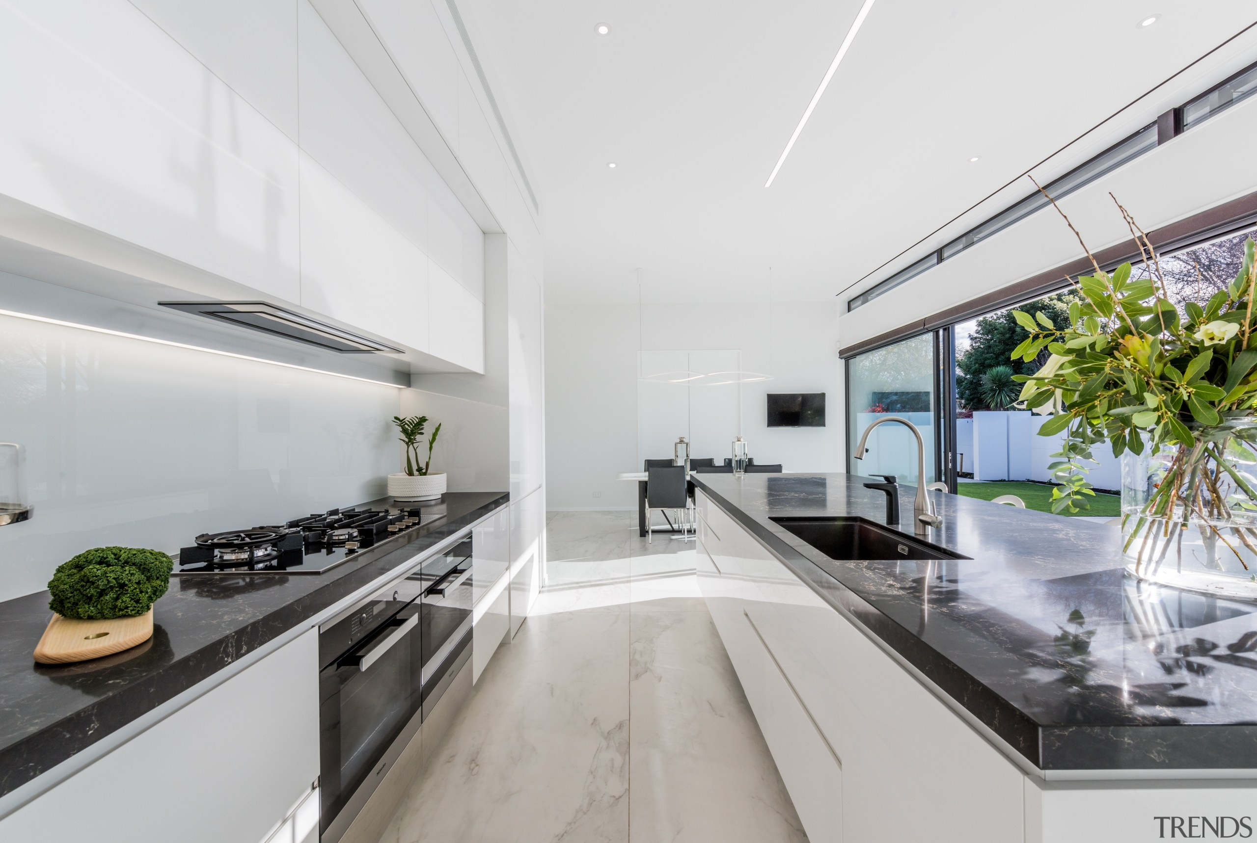 The long, clean lines of this kitchen match architecture, countertop, benchtop, Ceasarstone, kitchen, white cabinetry, Island, appliances, Emma Morris, Eterno Design