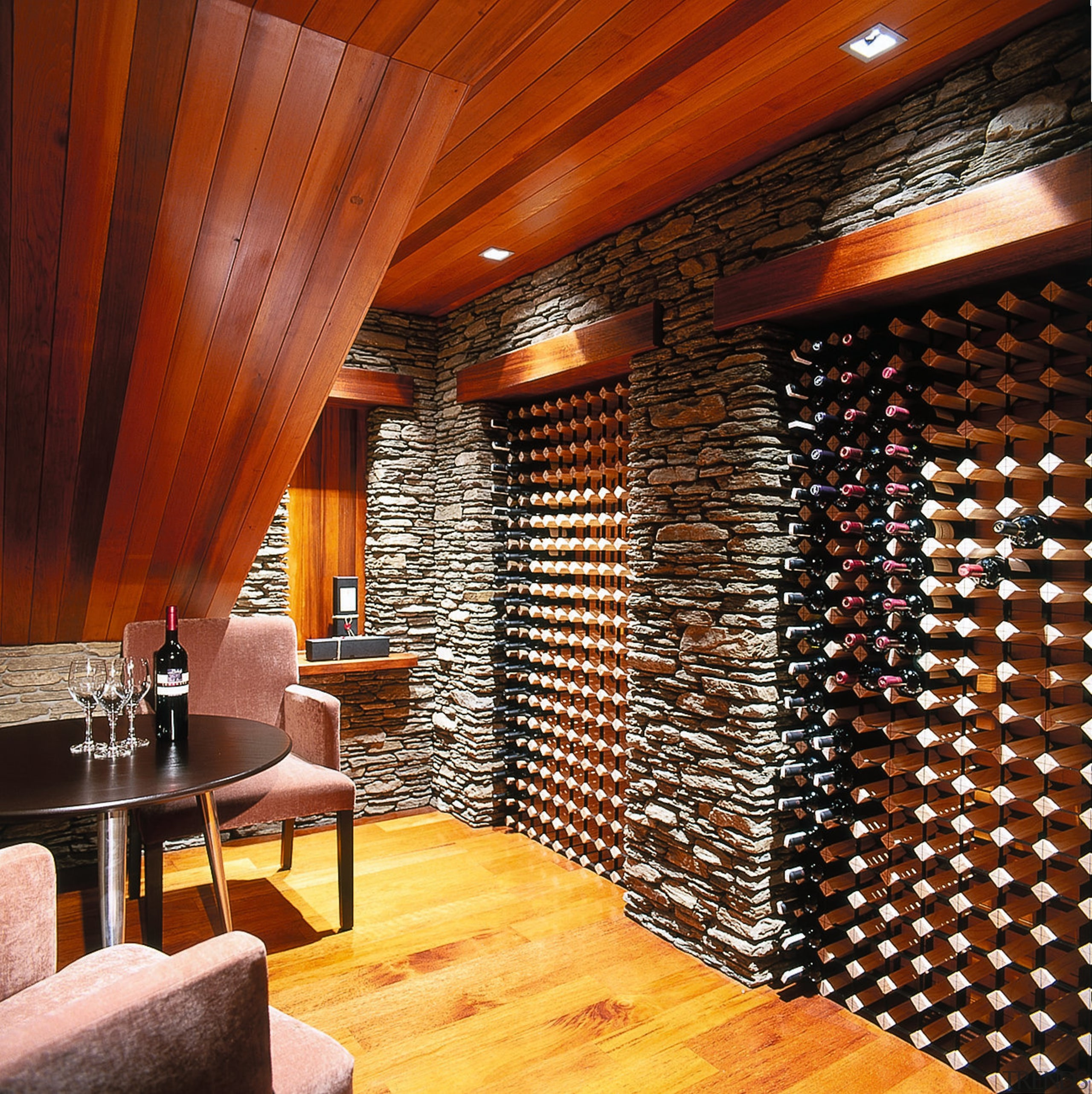 Inner view of wine cellar. Features a raked ceiling, flooring, interior design, lobby, wall, wine cellar, wood, red