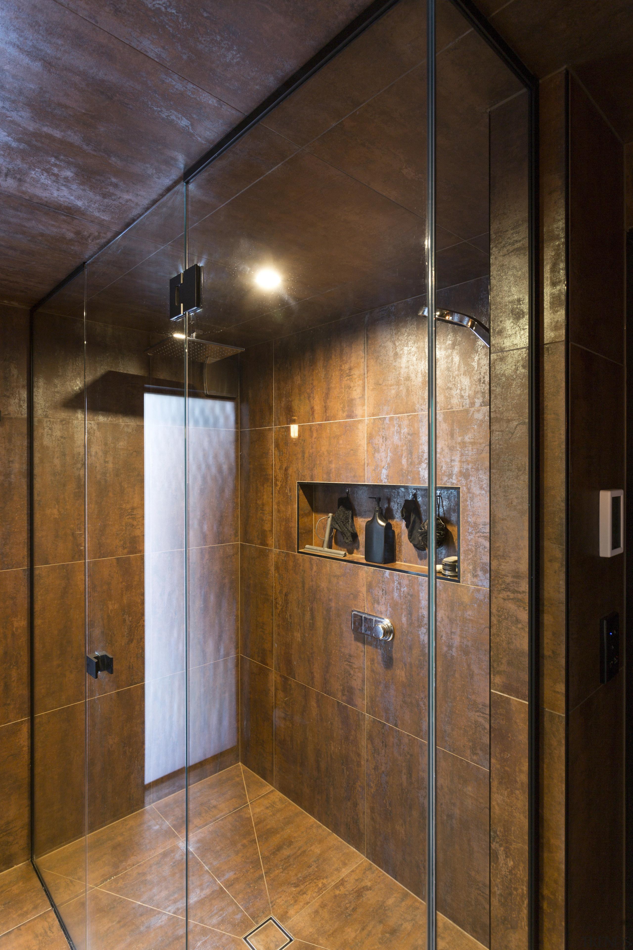 To bring light into this bathroom, designer Hayley bathroom, ceiling, floor, flooring, interior design, lighting, room, tile, wall, wood, wood flooring, brown