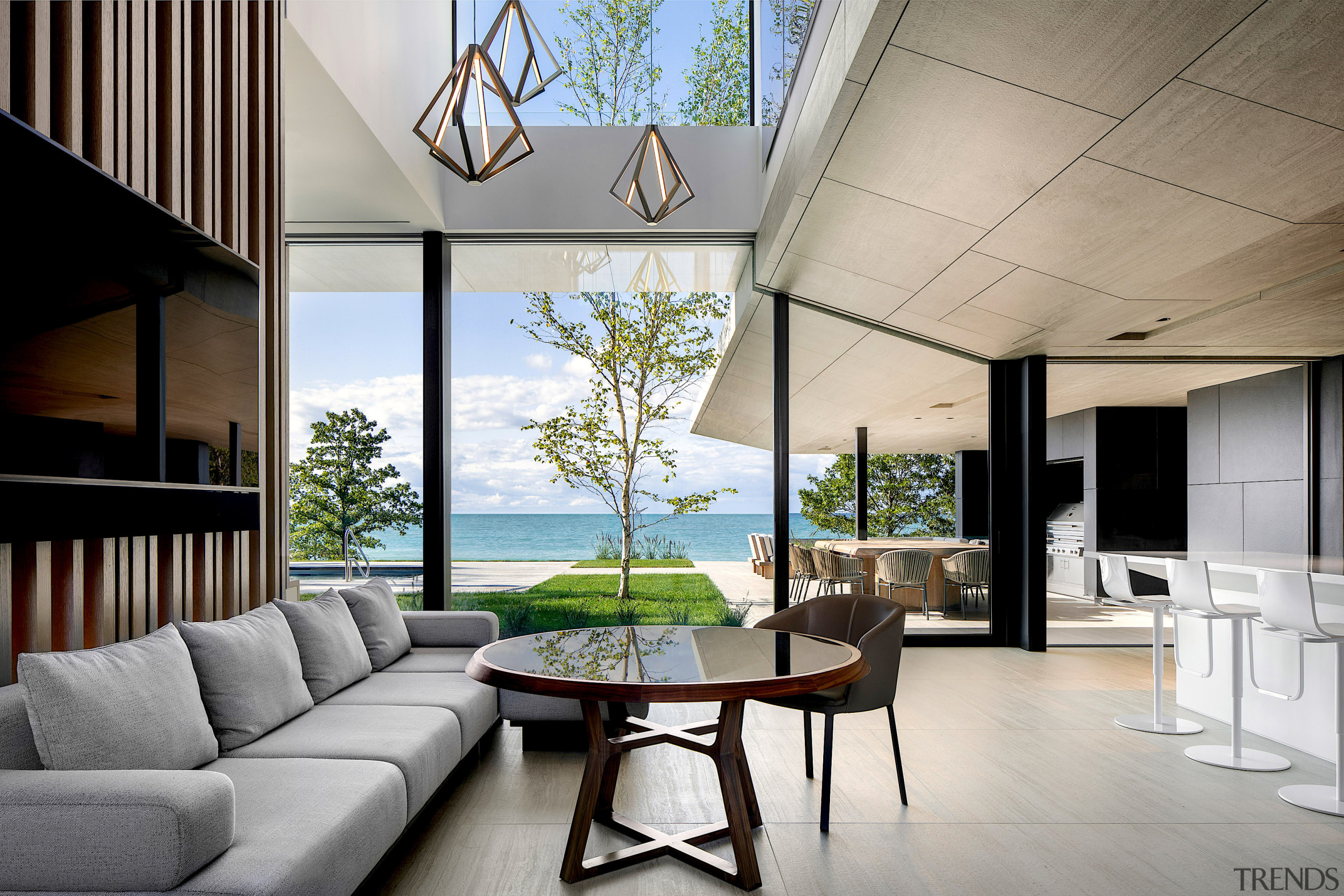 The dramatic triple-volume atrium lets in natural light