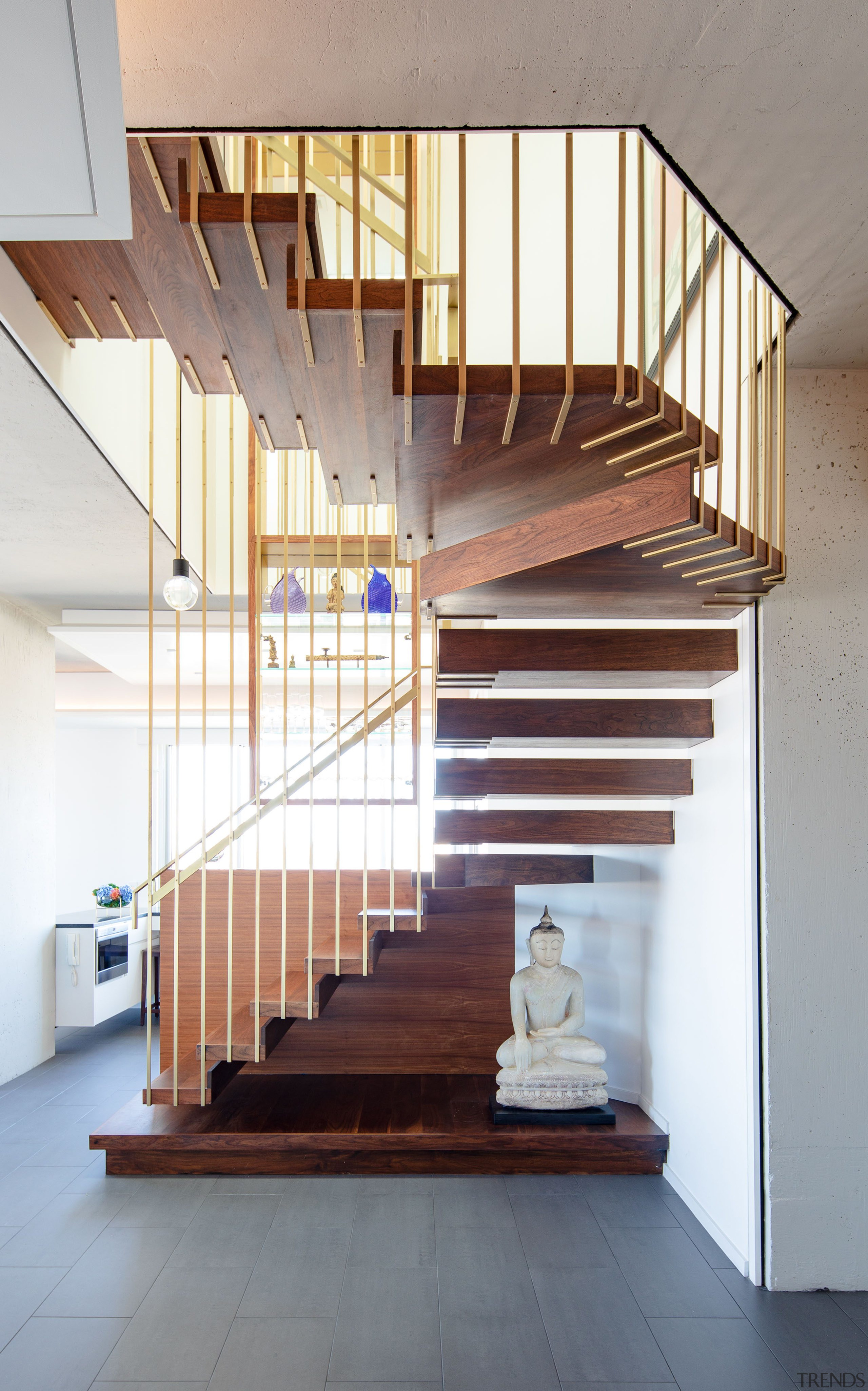 Steel rods dipped in brass are suspended 7.3m architecture, Penthouse, stairway, handrail, home, interior design, stairs, wood, suspended stairway, Andrew Wilkinson