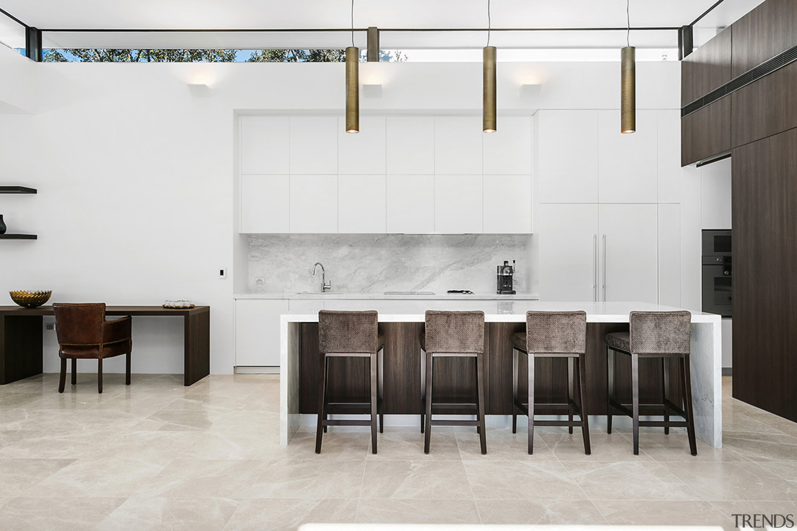 Tall order – this kitchen achieves drama through chair, floor, flooring, furniture, interior design, table, wall, white