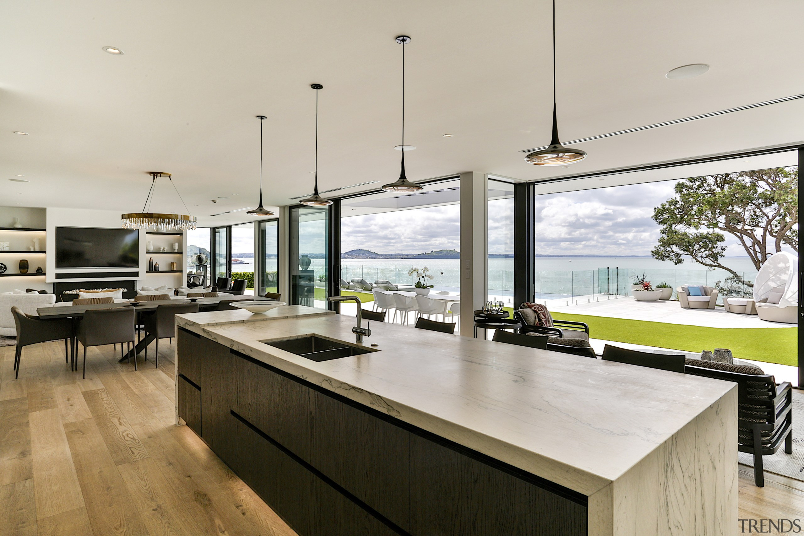 The kitchen Island with a raised waterfall block gray
