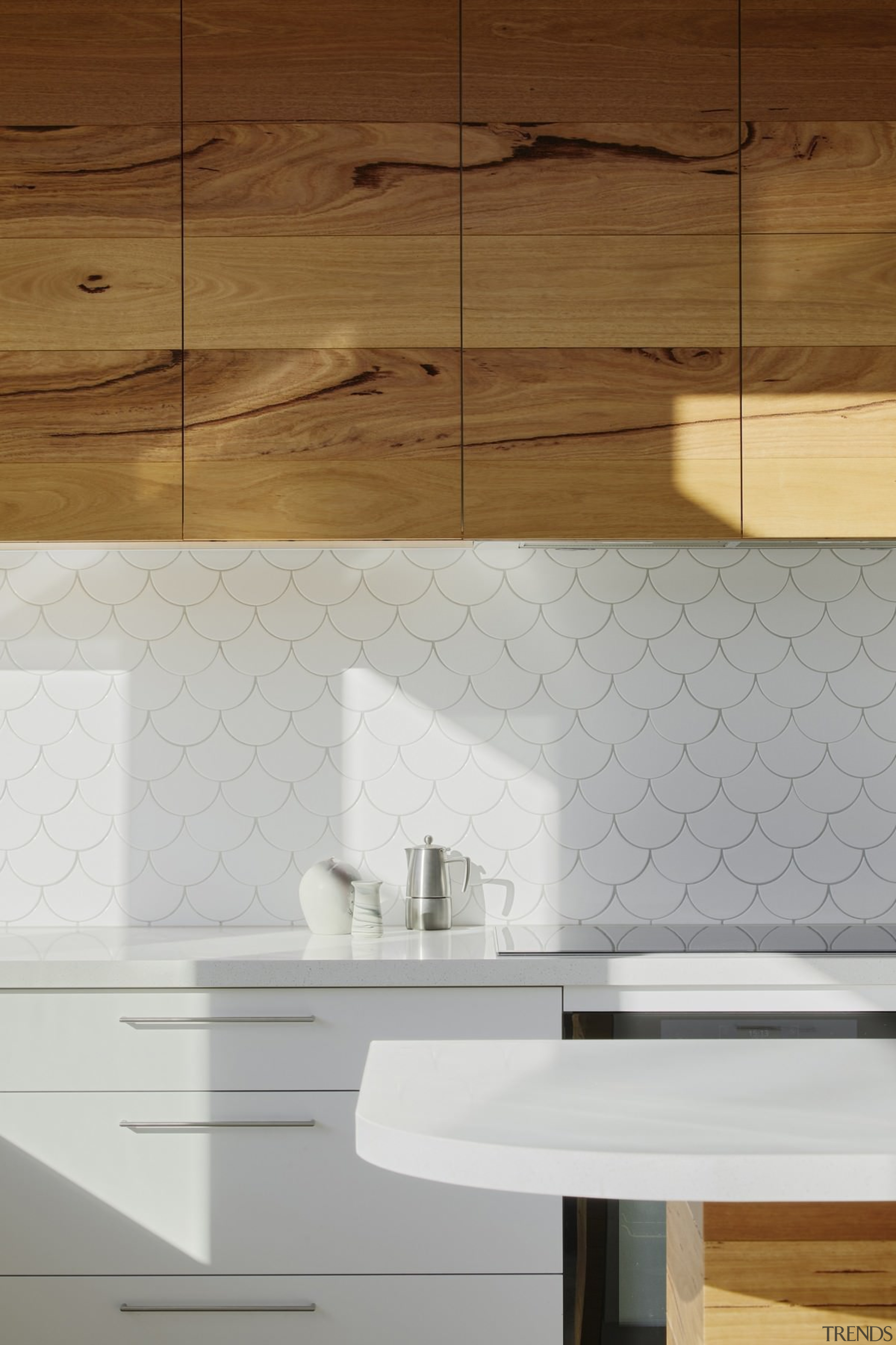 Soft touches line the new living space, including angle, architecture, cabinetry, ceramic, countertop, floor, flooring, hardwood, interior design, plywood, product design, sink, tap, tile, wall, wood, wood flooring, wood stain, brown, gray