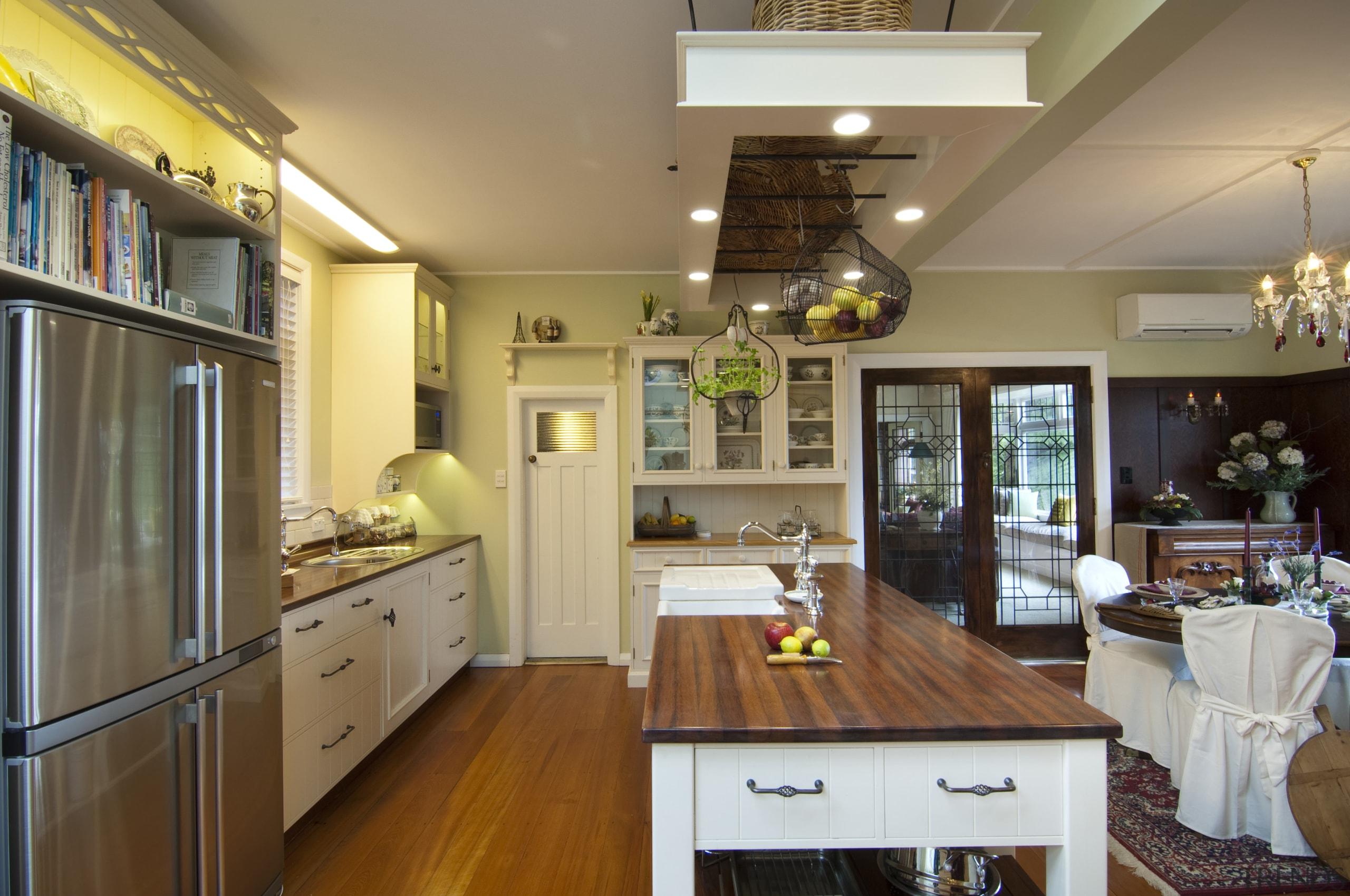 refrigerator, island and rangehood, floor and sink ceiling, countertop, interior design, kitchen, living room, real estate, room, brown