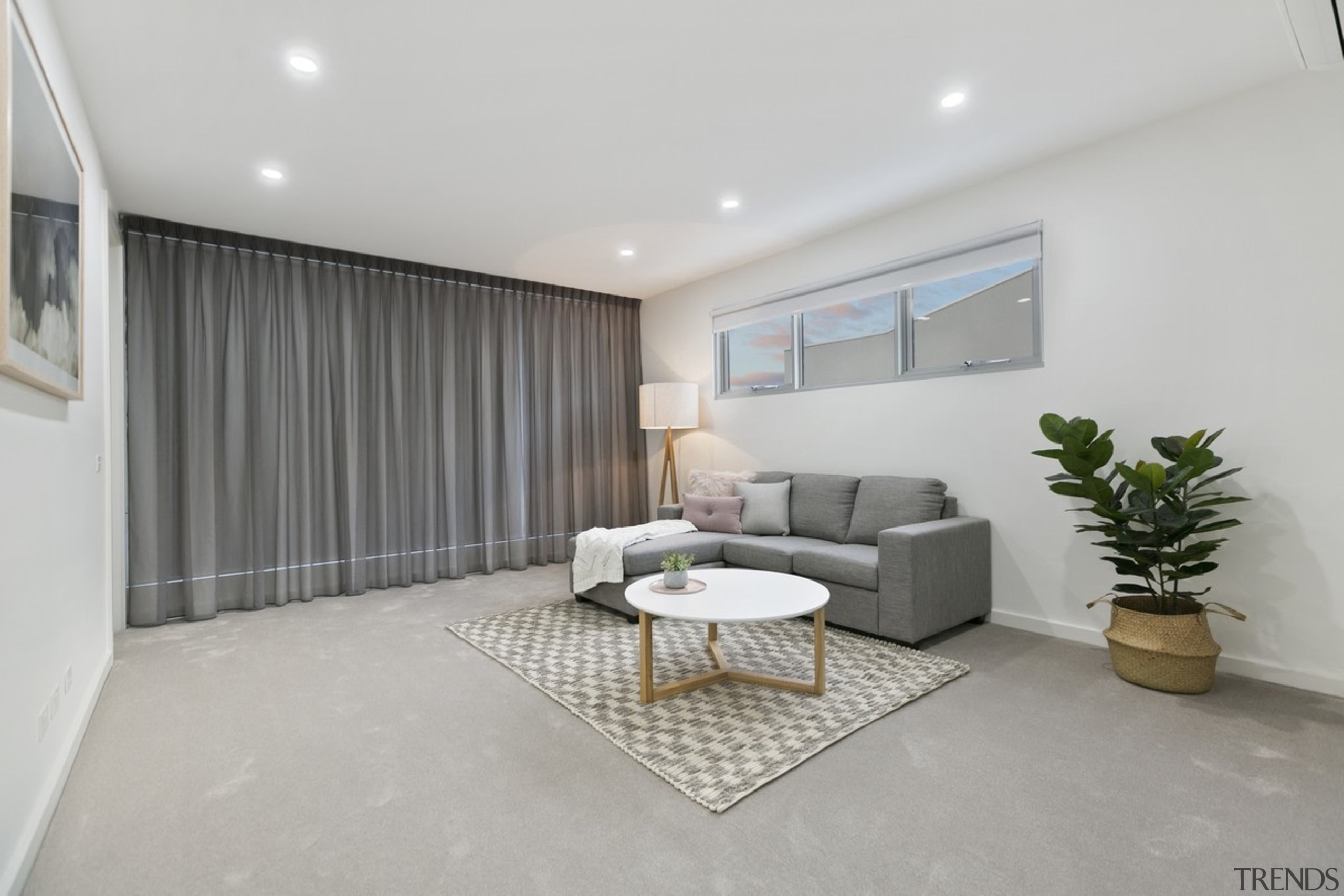 This second level living room is similarly open floor, interior design, property, real estate, gray
