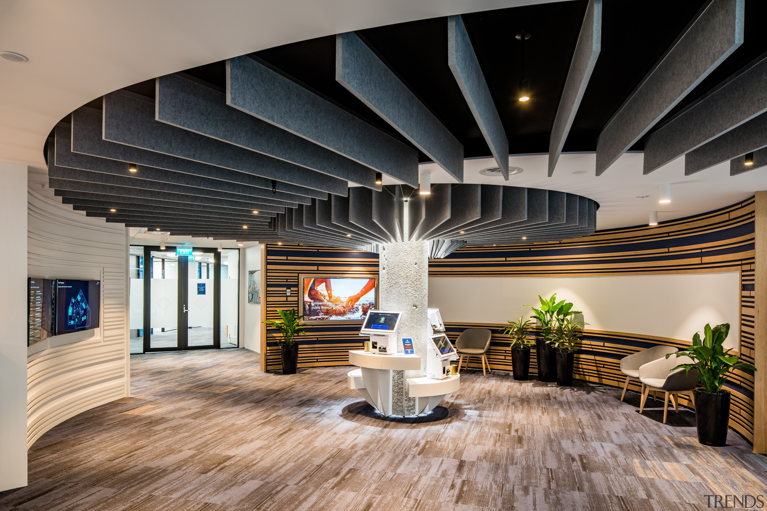 An immovable column is disguised by a koru architecture, building, hardwood floor, Treasury Office, interior design, timber flooring, lobby, black, gray, Lobby, Precinct Properties, Workspace Architects