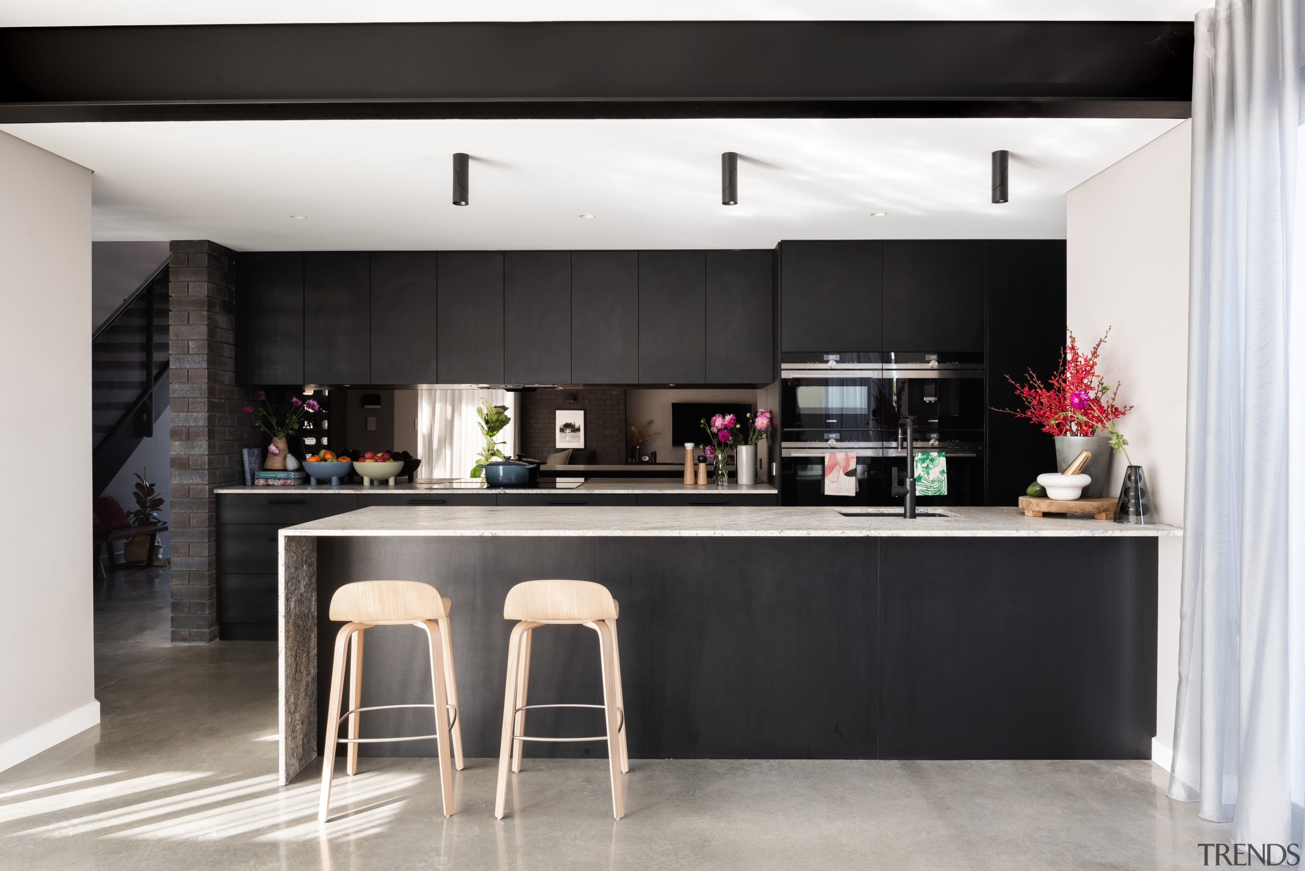 This living zone's dark tones balance the natural architecture, black, black-and-white, cabinetry, countertop, dining room, floor, flooring, furniture, home, house, interior design, kitchen, table, tile, black, , Dalecki Dsign