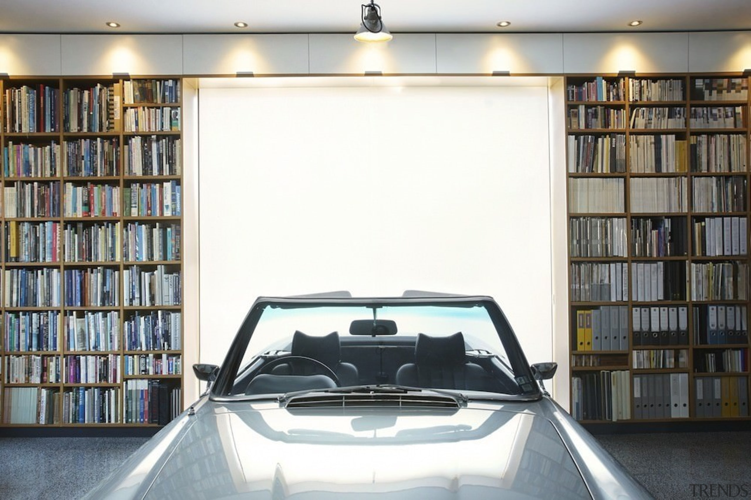 This library/garage has plenty of utility - This automotive design, automotive exterior, car, family car, motor vehicle, vehicle door, white, gray