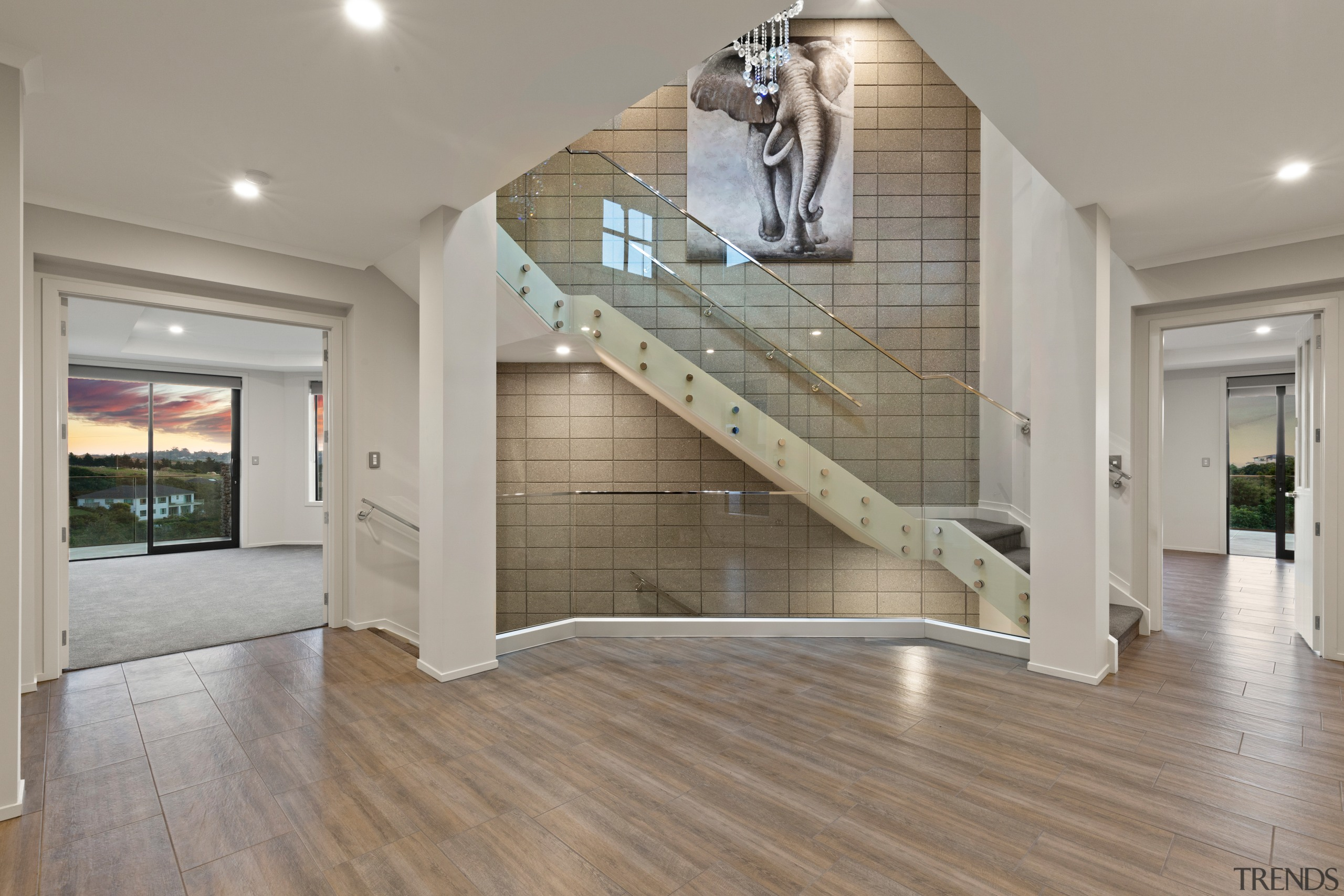 This spacious, modern three-level home, boasts 3m studs architecture, building, ceiling, estate, floor, flooring, glass, hall, hardwood, home, house, interior design, laminate flooring, living room, lobby, loft, property, real estate, room, stairs, wall, wood, wood flooring, gray