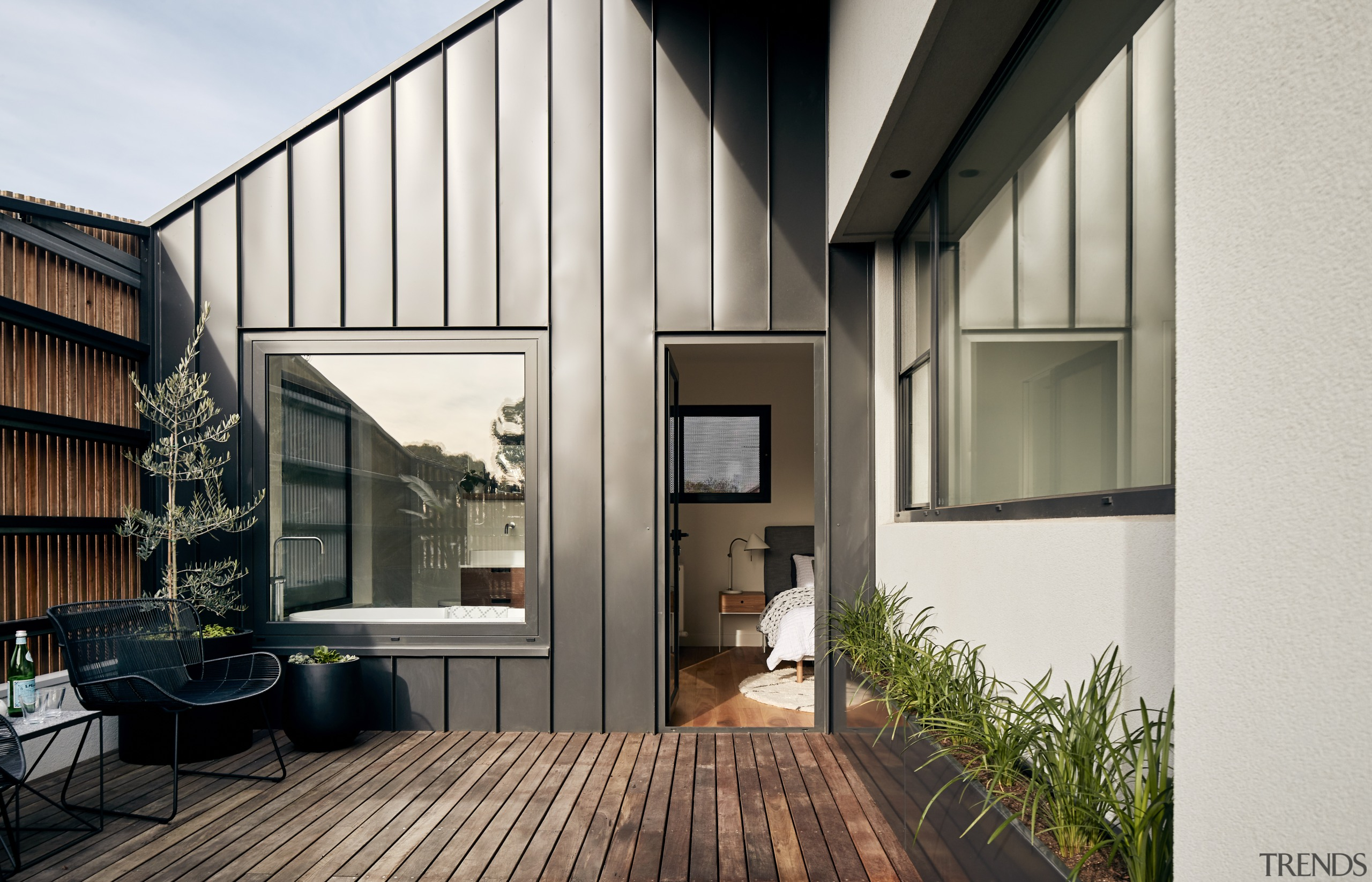 The lines of the standing seam cladding work apartment, architecture, building, ceiling, courtyard, daylighting, facade, floor, hardwood, home, house, interior design, loft, property, real estate, residential area, roof, room, siding, wall, window, wood, white, black