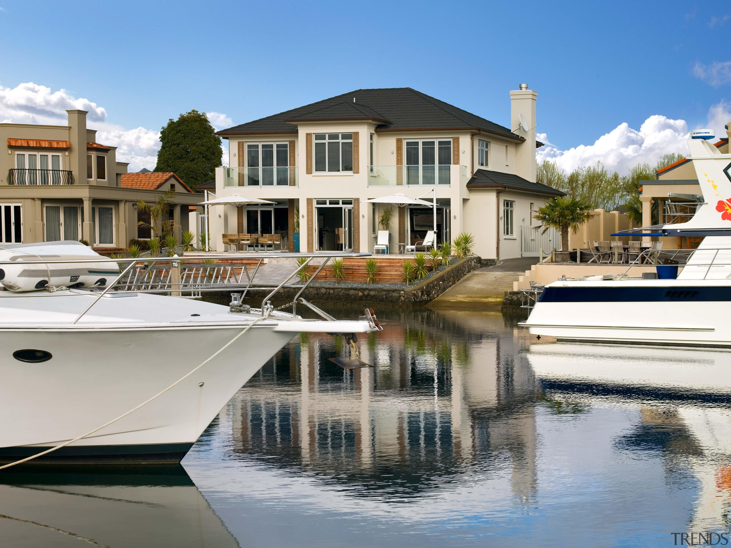 pauanui  mds exterior 1 - pauanui__mds_exterior_1 - boat, condominium, dock, home, house, marina, property, real estate, reflection, residential area, water, water transportation, waterway