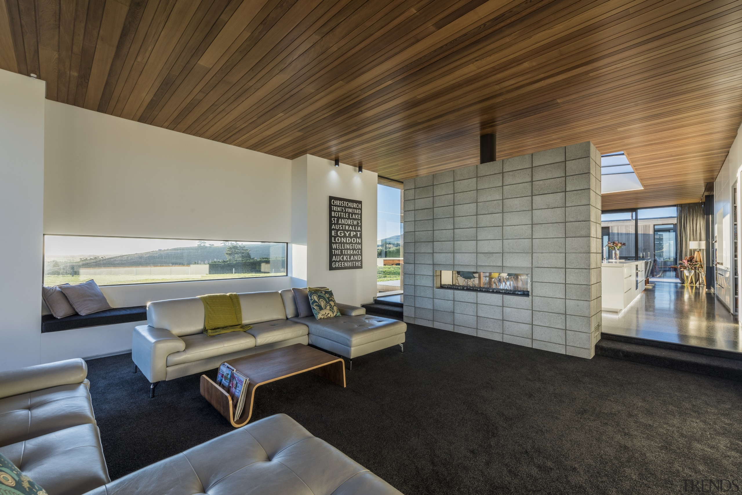 Separated by a partial wall from this homes architecture, ceiling, house, interior design, living room, real estate, gray, brown