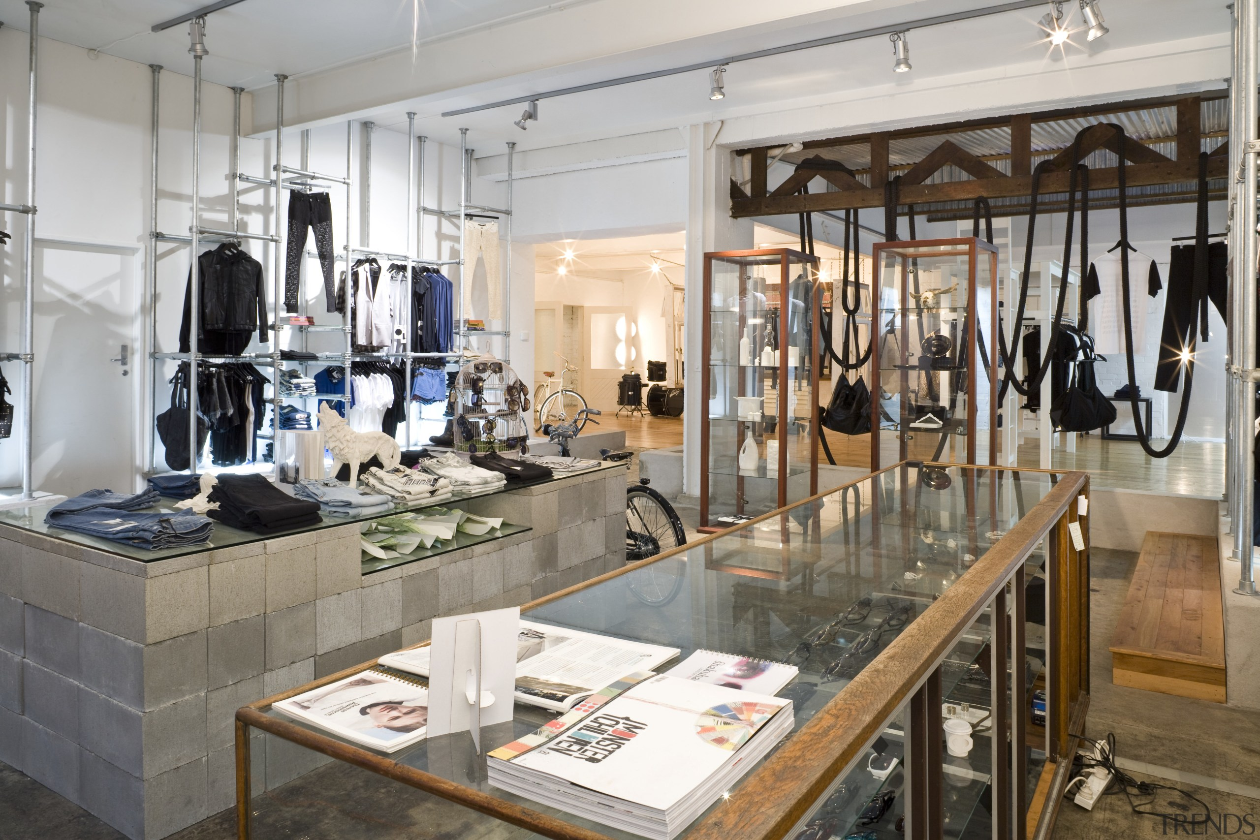 Interior view of the clothing displays at the boutique, interior design, retail, gray