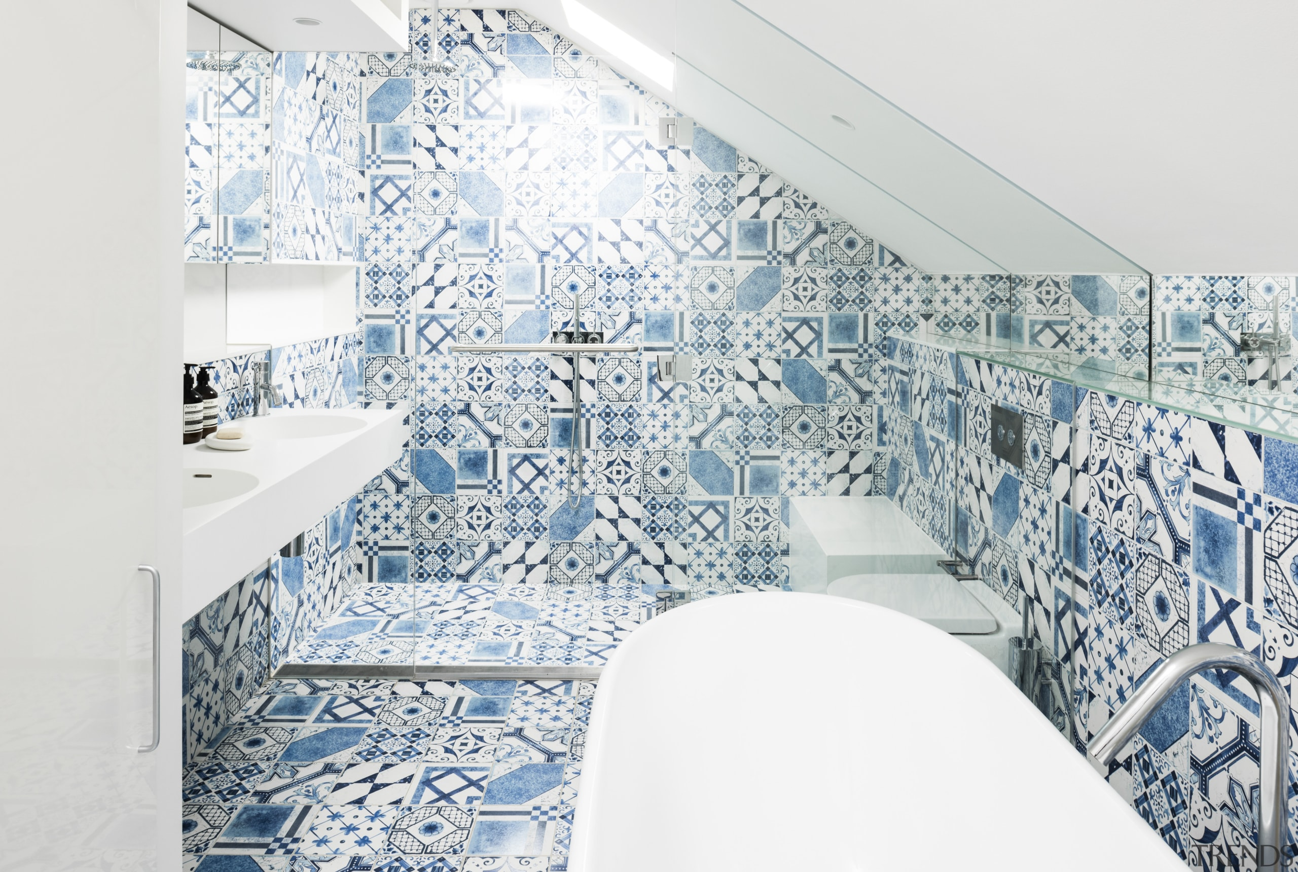 The tilework in this terrace house top-floor bathroom architecture, blue, design, interior design, room, wall, white