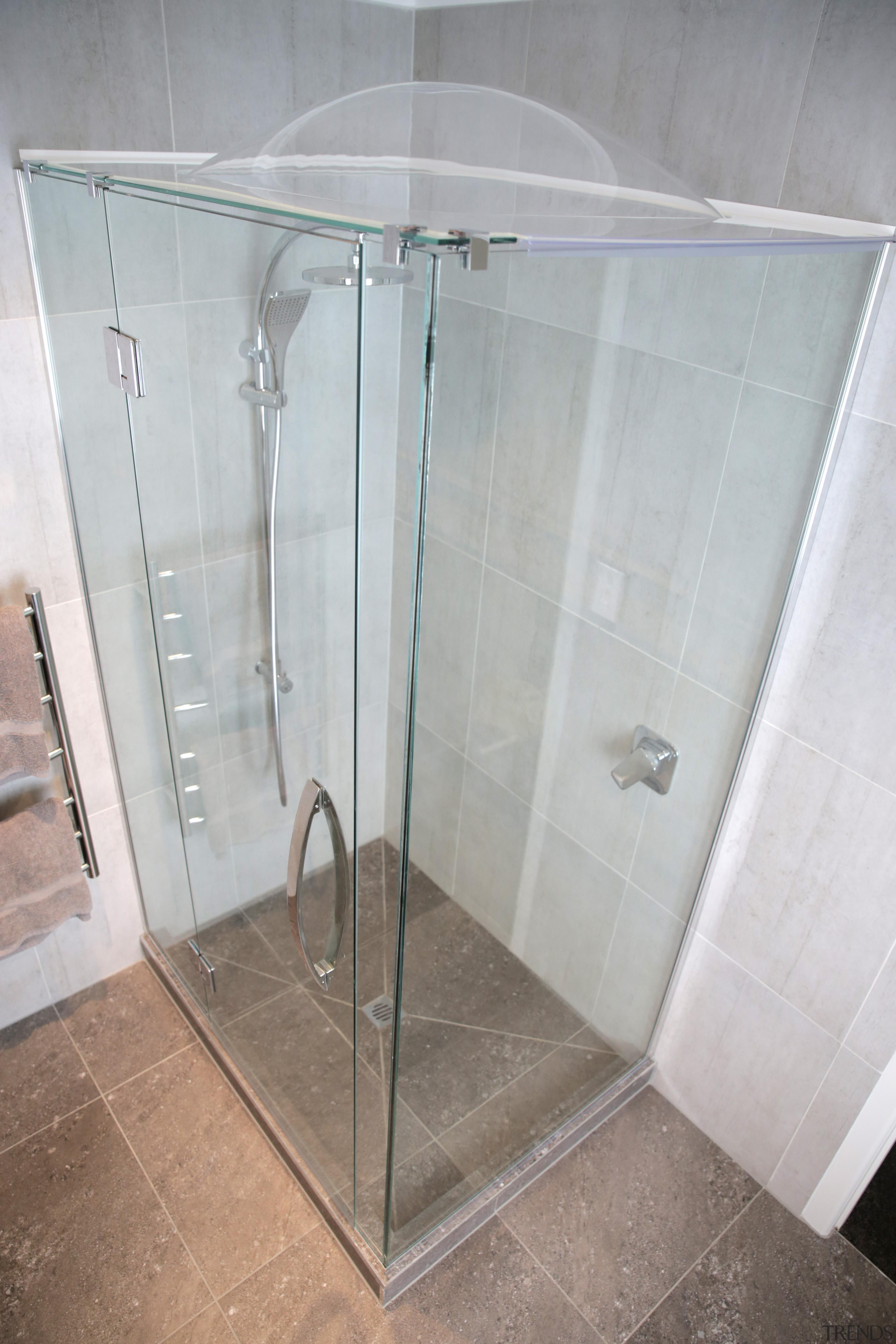 Enjoy the benefits of a drier, healthier home angle, glass, plumbing fixture, shower, gray