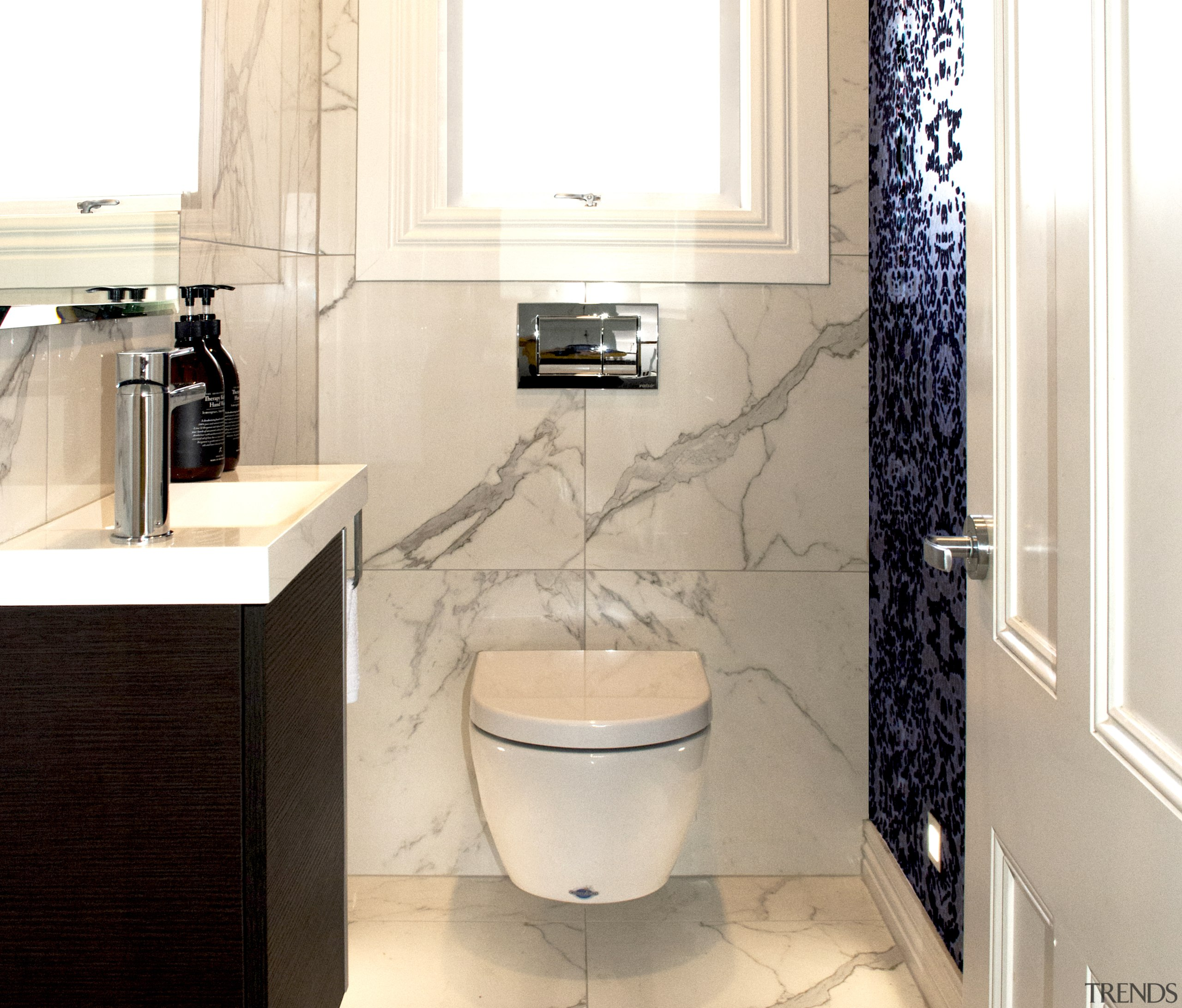 Being used solely by the children, the wallpaper architecture, bathroom, bathroom accessory, bathroom cabinet, bidet, floor, home, interior design, wallpaper, marble, material property, plumbing, plumbing fixture, property, room, sink, tap, tile, toilet, toilet seat, wall, white